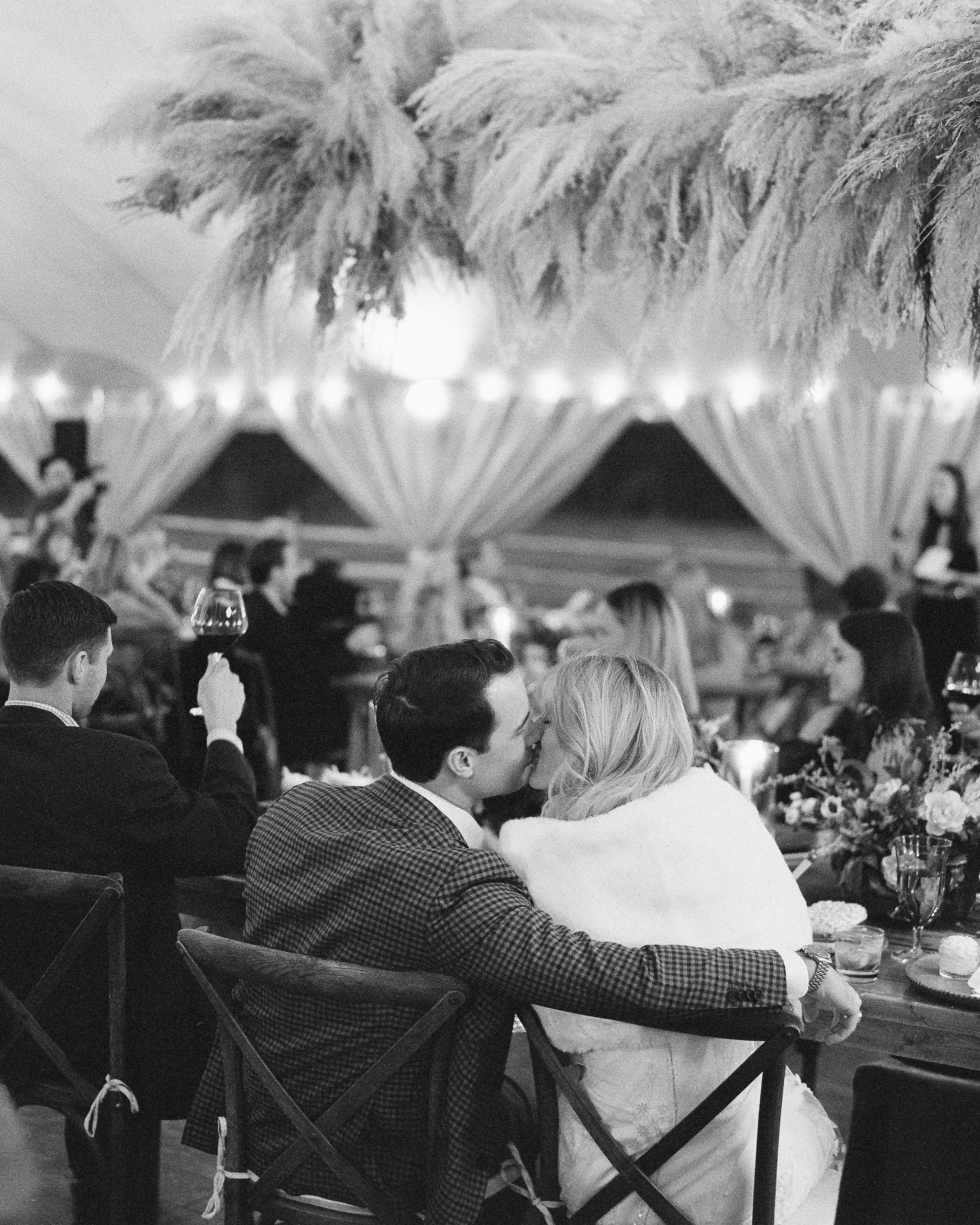 bride groom kiss at dinner