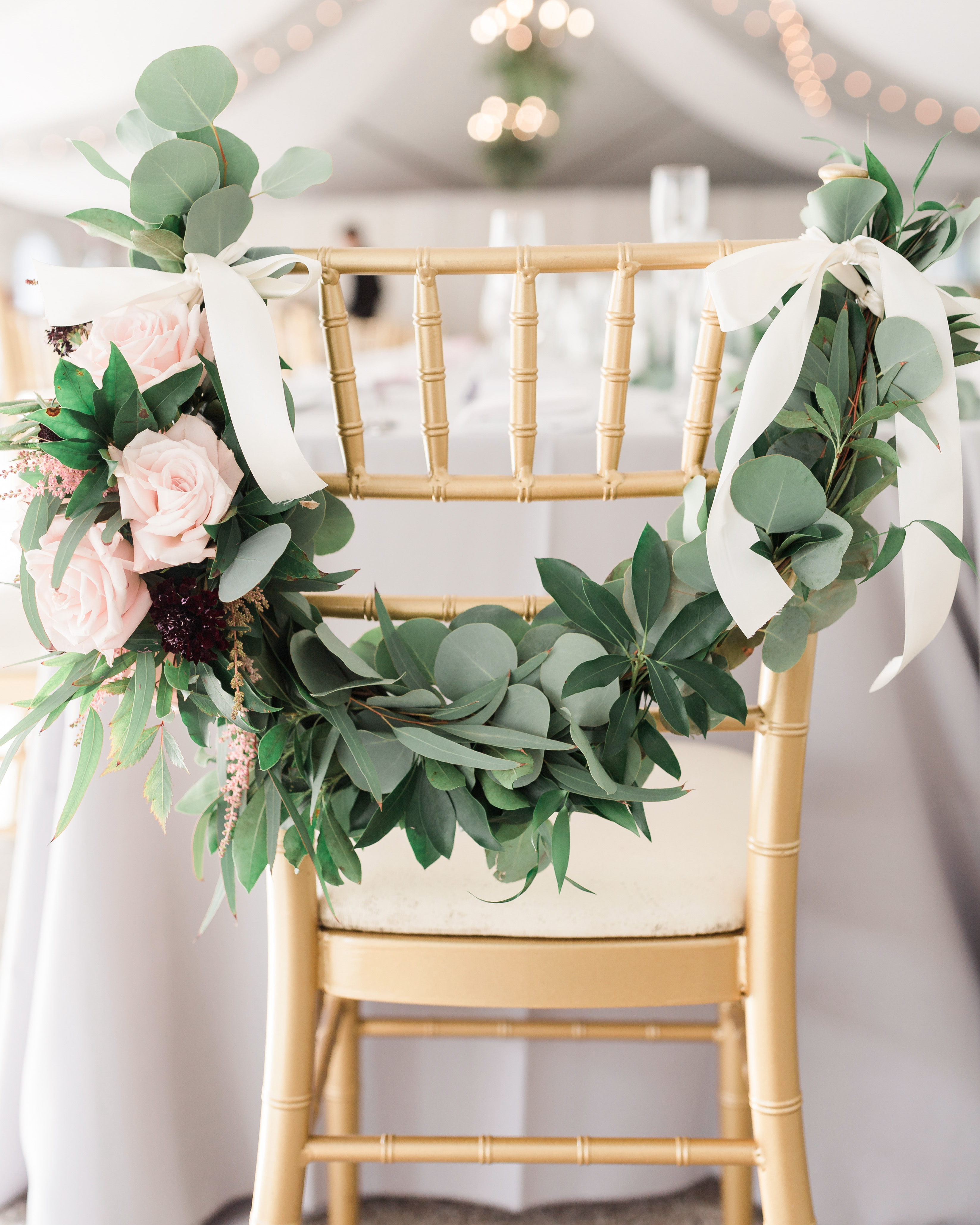 roses and astilbe around wood chair back