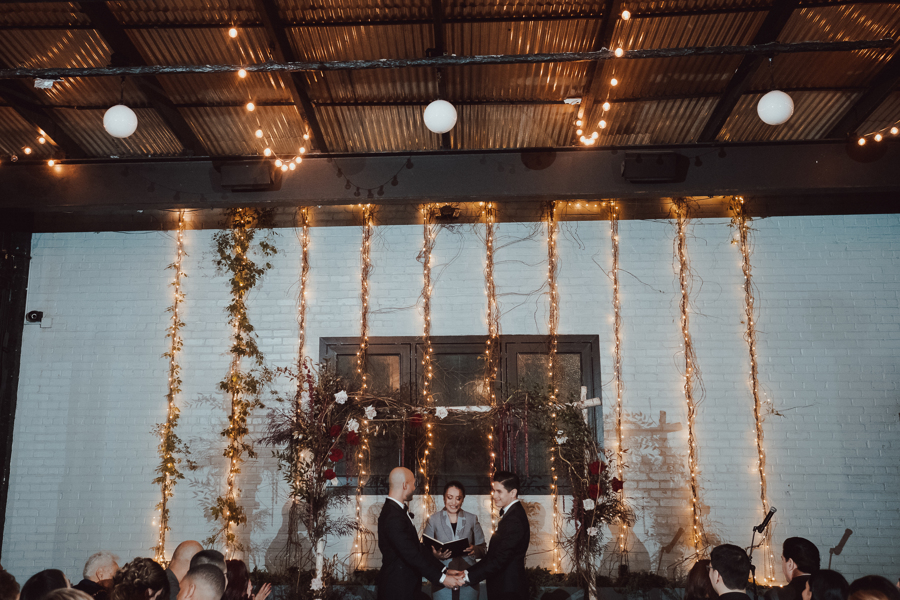 grooms standing at wedding alter