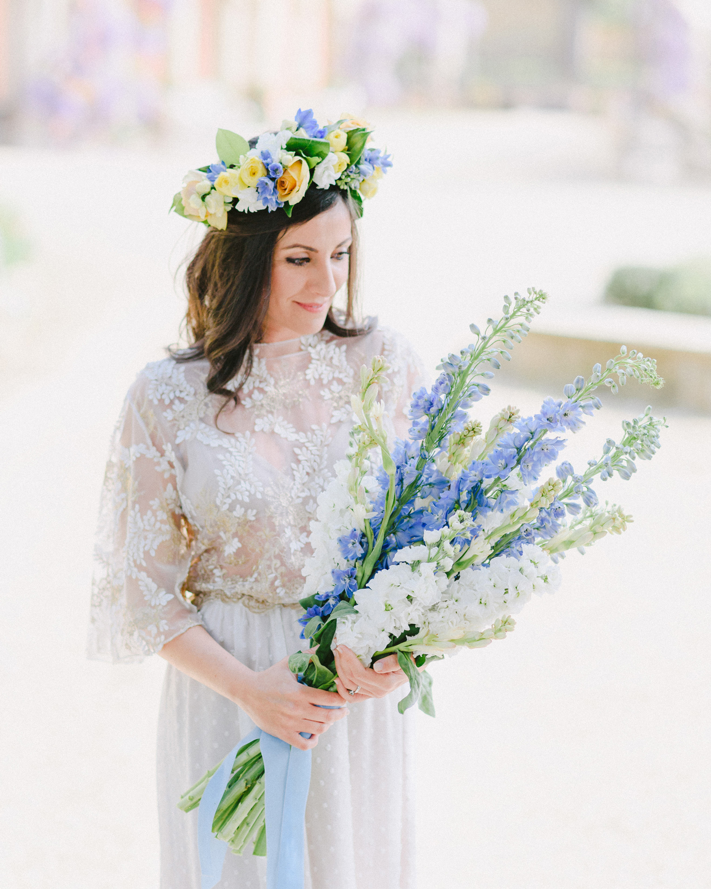 light blue and white long stemmed floral bouquet with blue ribbon