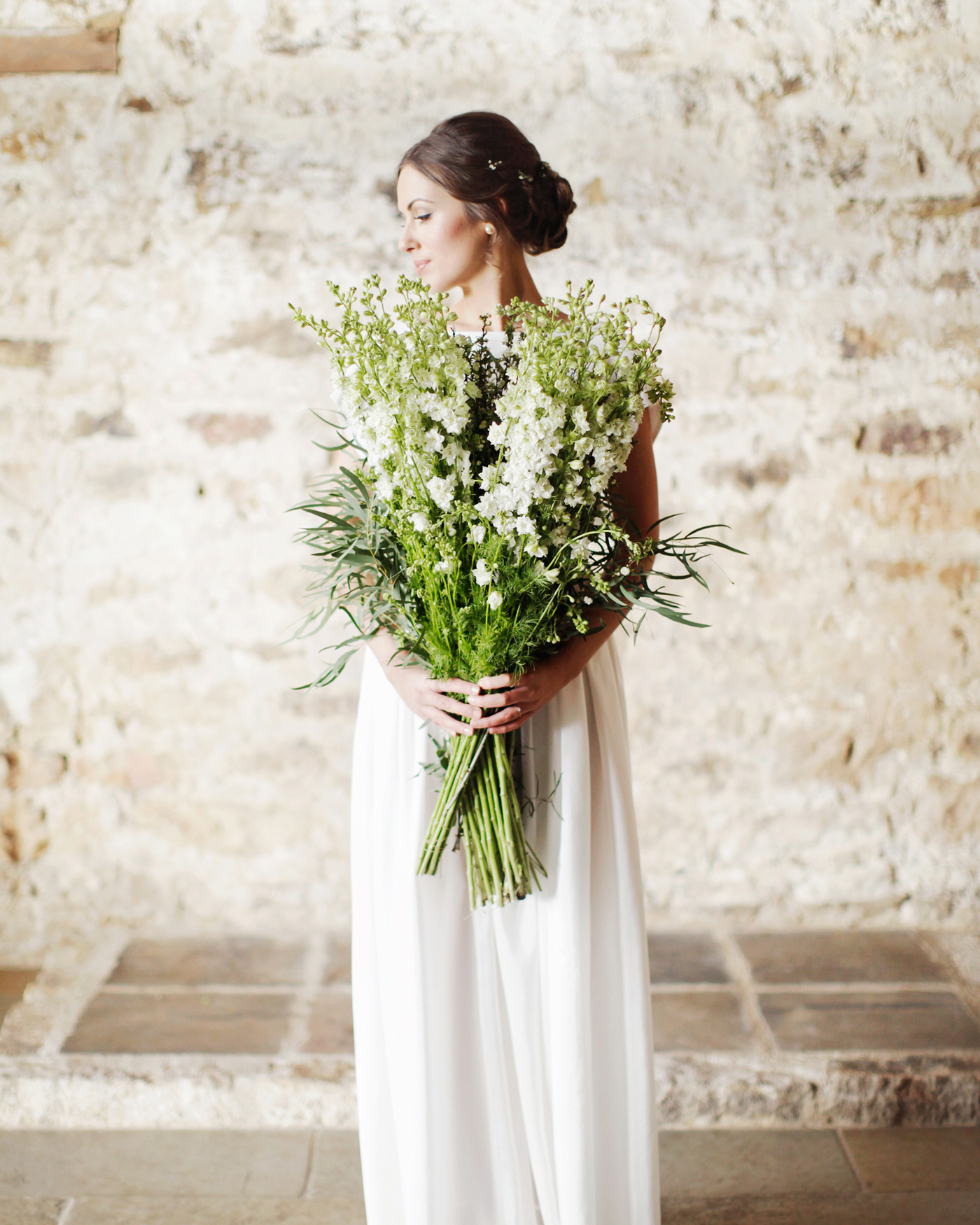 long stemmed greenery and white floral wedding bouquet mix