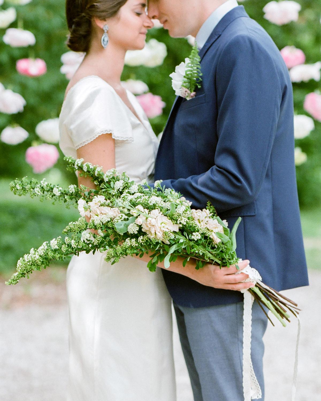 various white florals long stemmed wedding bouquet