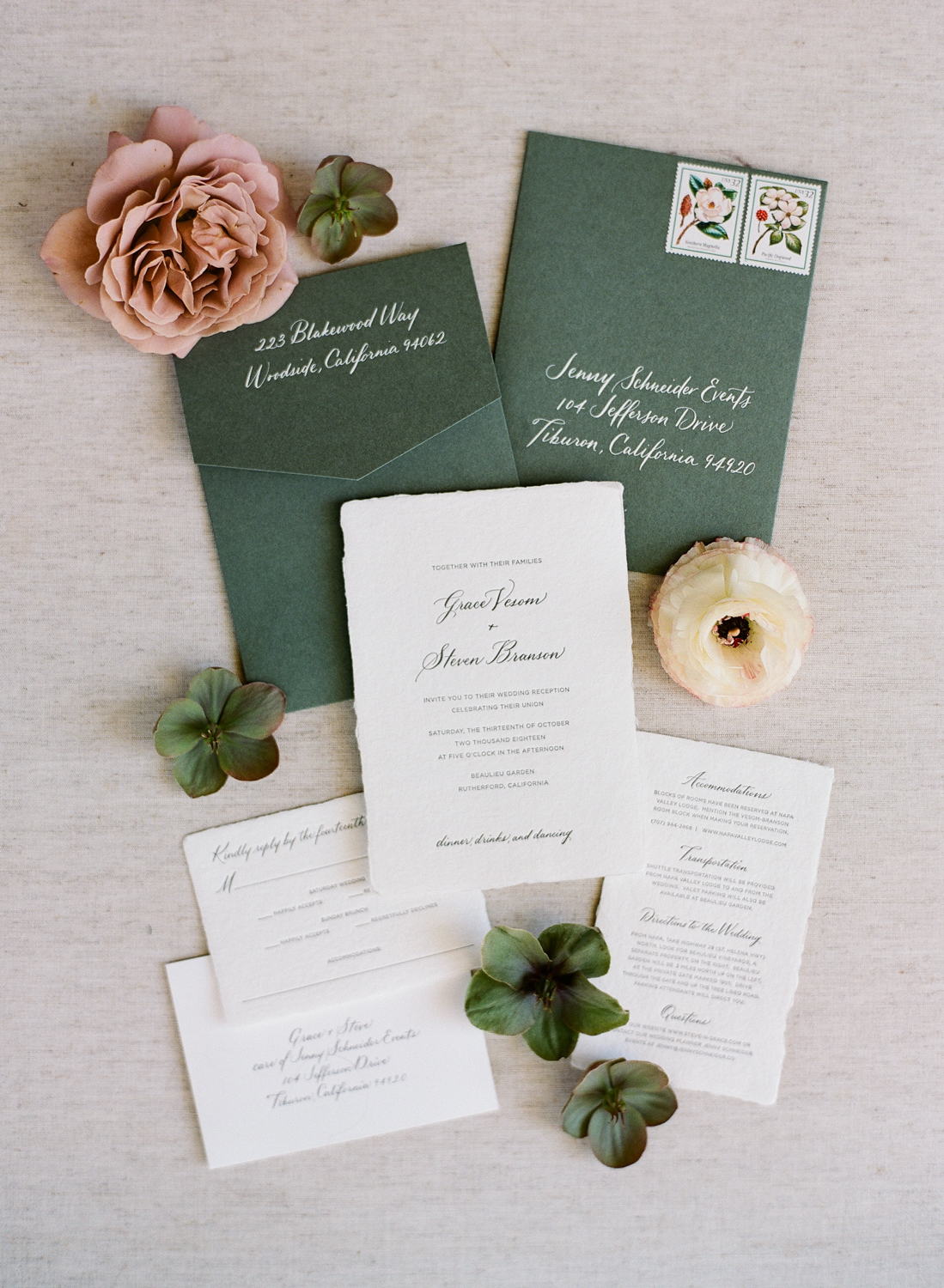 eggshell white deckle edged wedding stationary suit with forest green envelopes