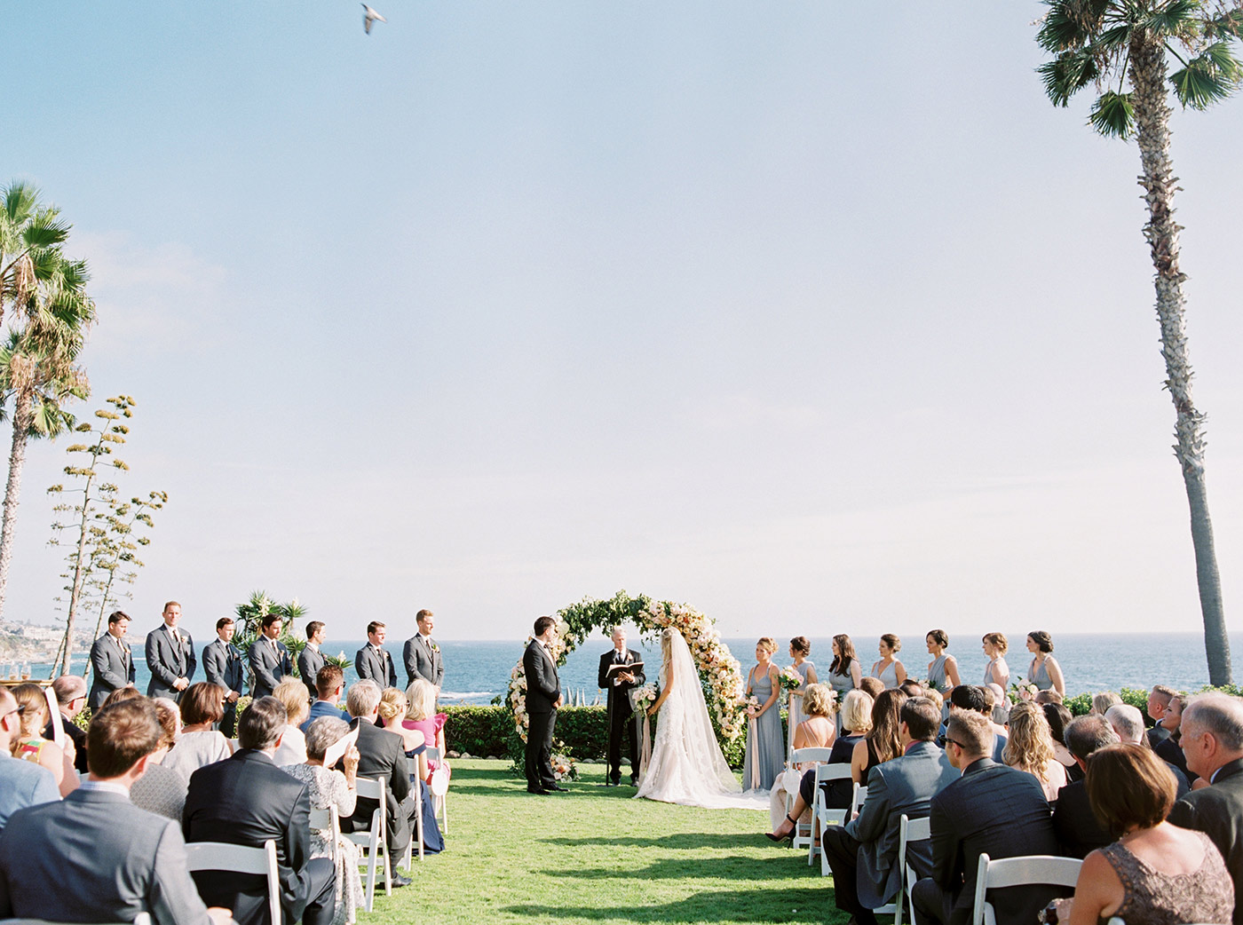 mykaela and brendon wedding ceremony on lawn facing ocean