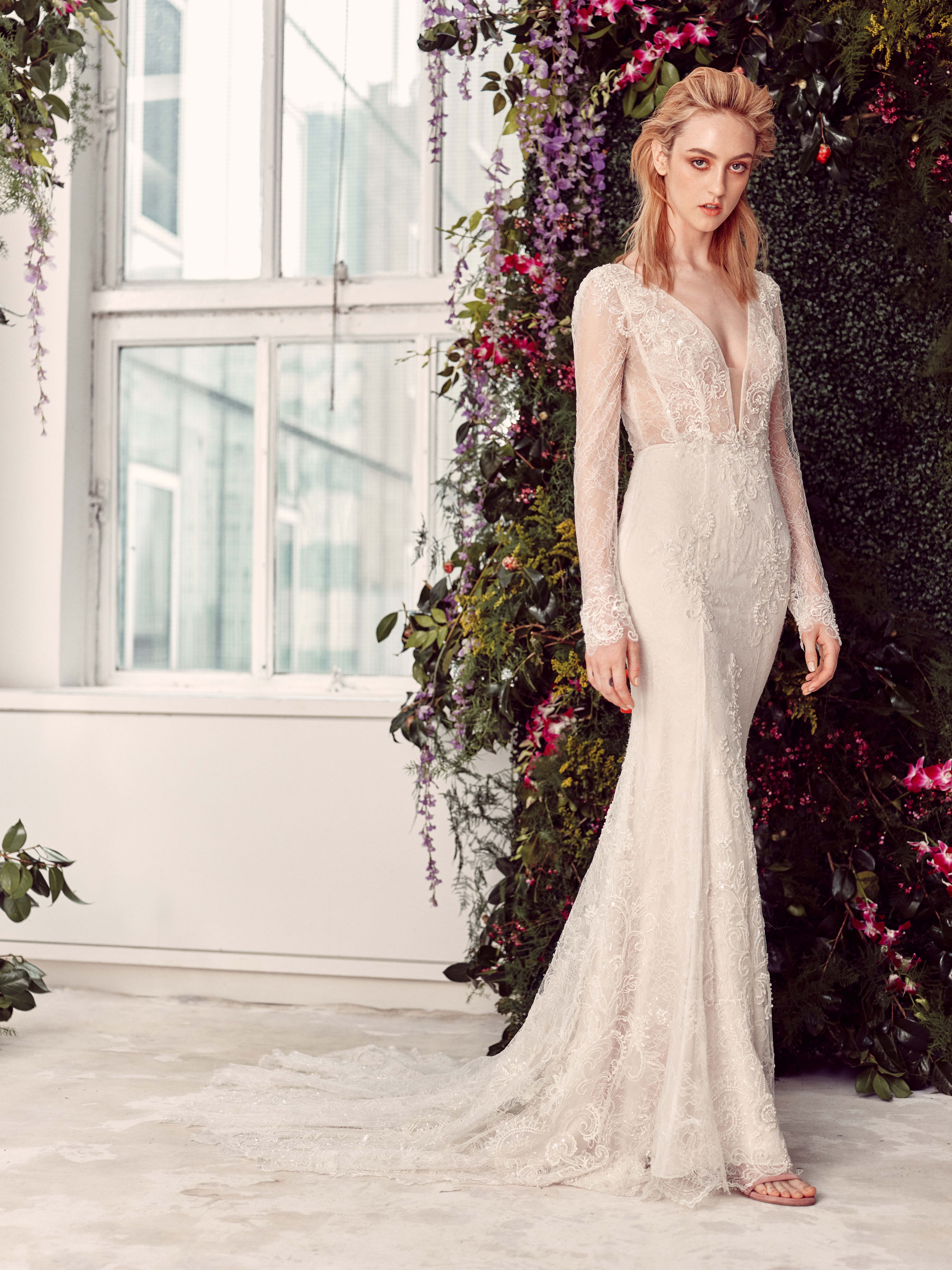 sheer lace long sleeves deep v-neck bodice semi trumpet wedding dress Rivini by Rita Vinieris Spring 2020