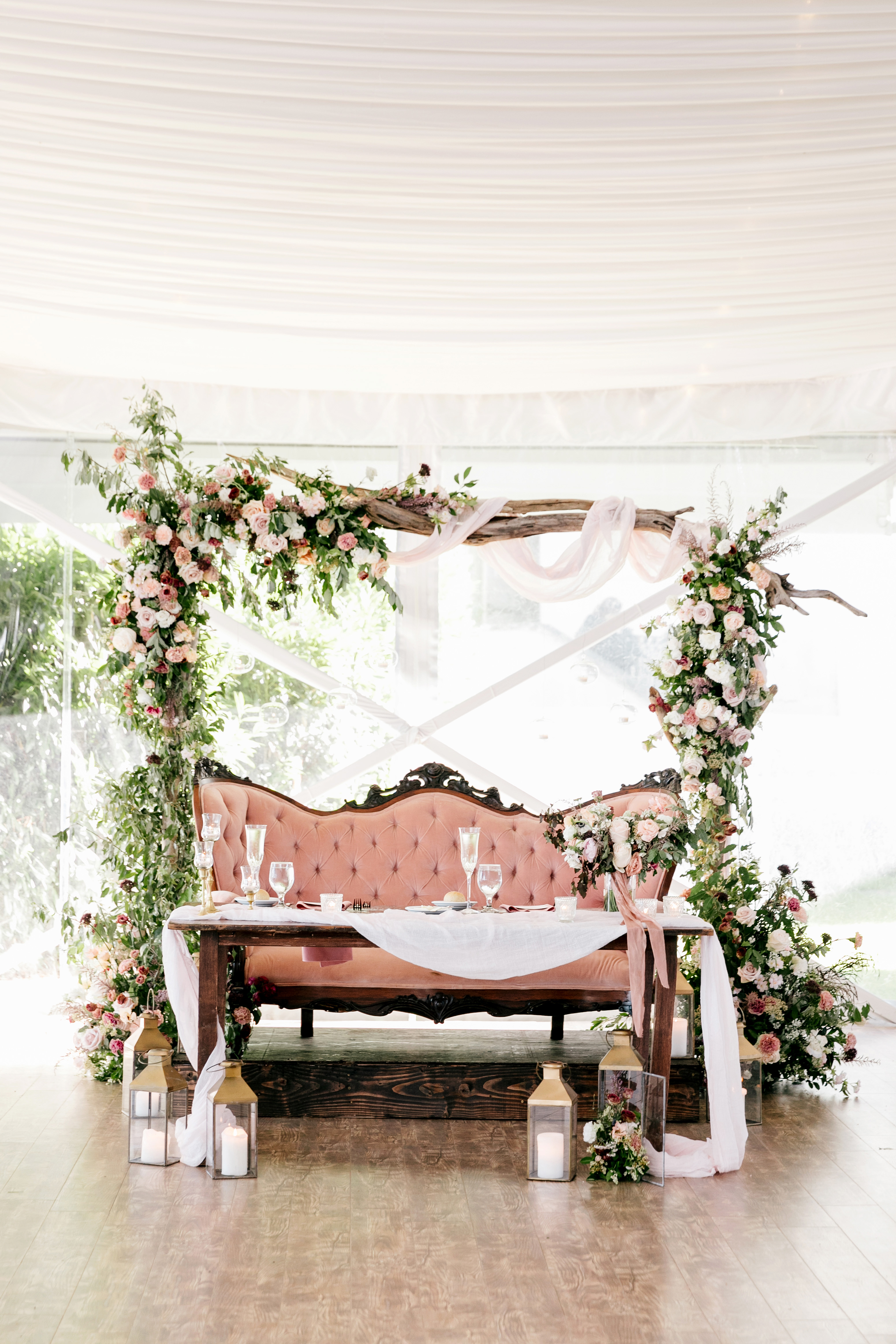 sweetheart table floral arch pink love seat