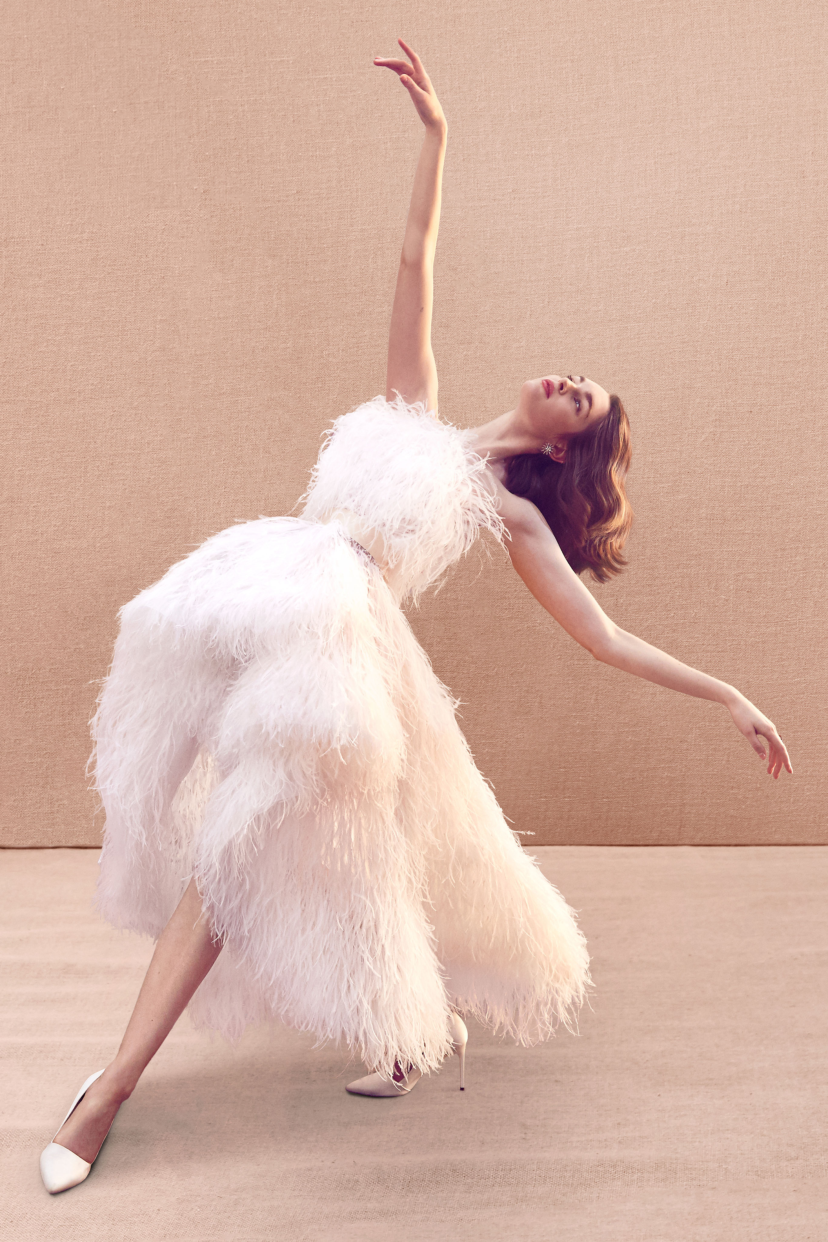 sleeveless high-low feather a-line wedding dress Oscar de la Renta Spring 2020