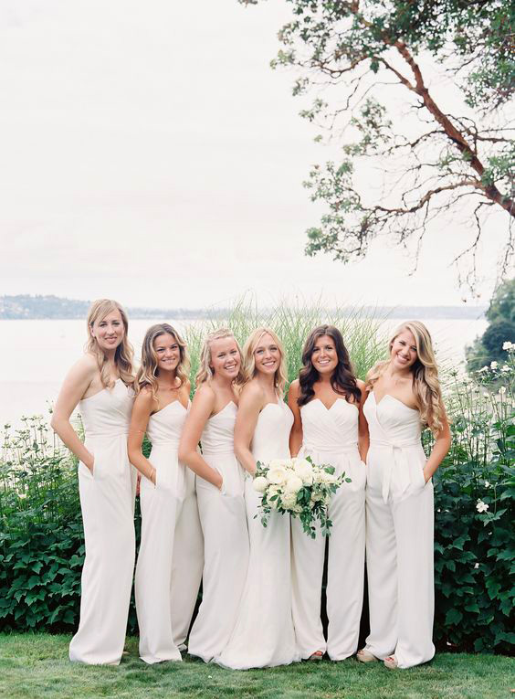 women wearing strapless white bridesmaids jumpsuits