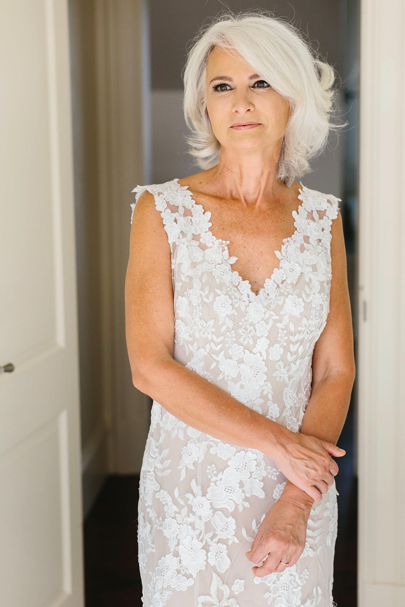 bride leaning against doorframe