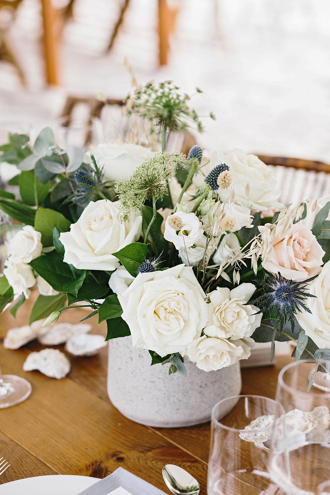 white rose wedding centerpiece on table