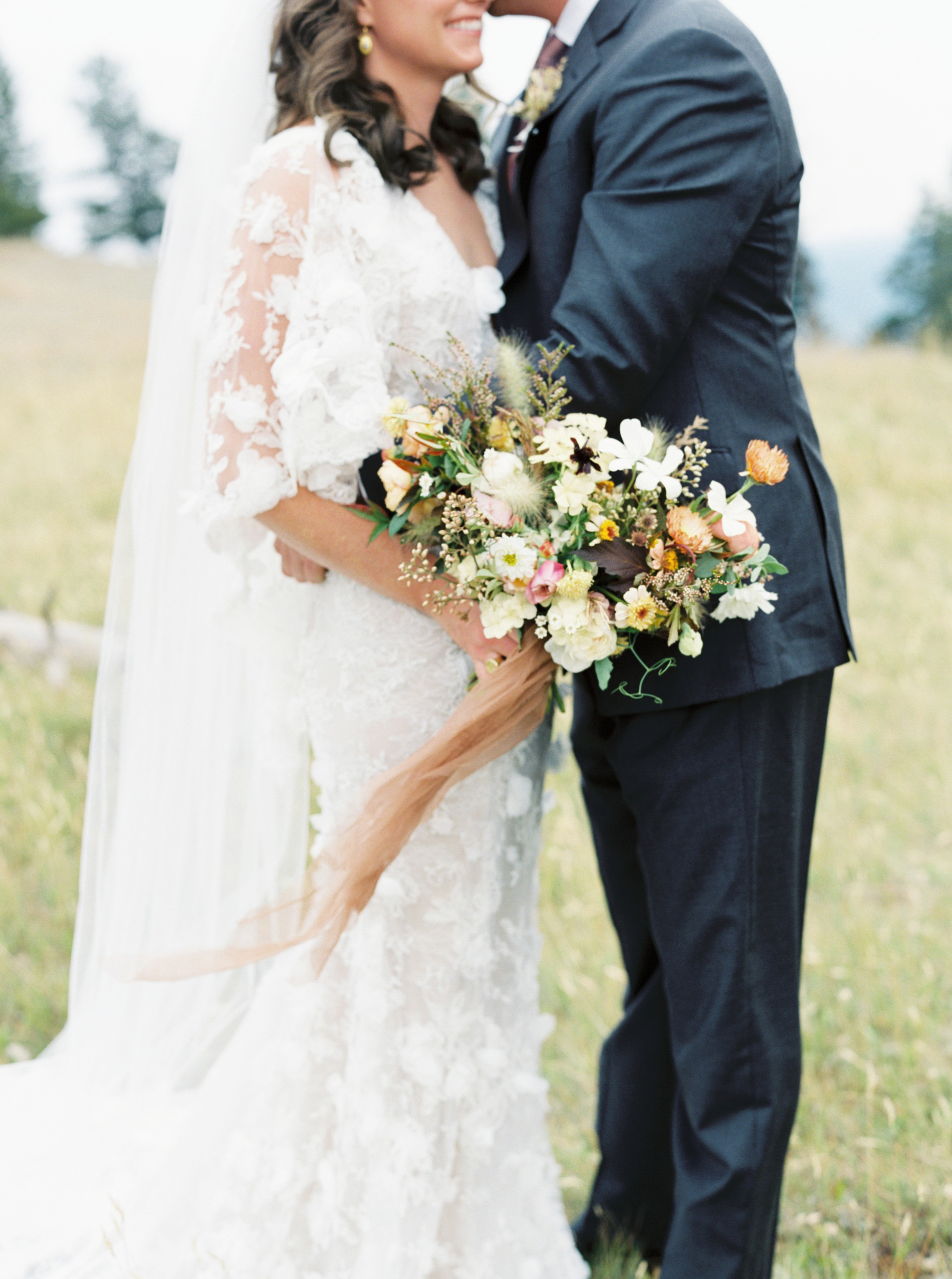ivory lacy plunging v-neck wedding dress with 3d organza flowers