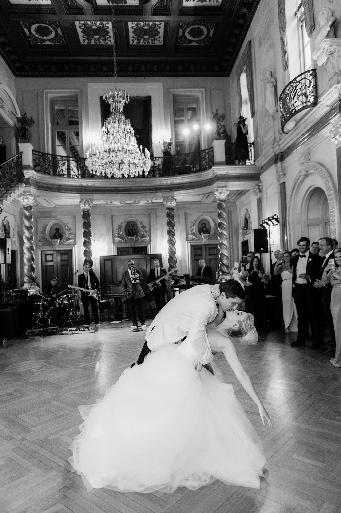 groom dips bride during reception on dance floor