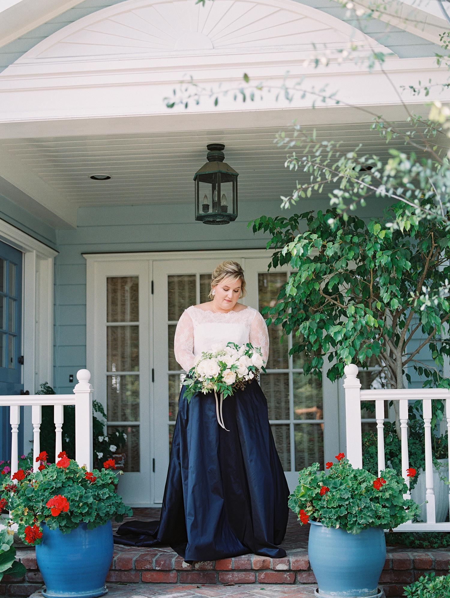 elizabeth scott wedding bride standing on porch