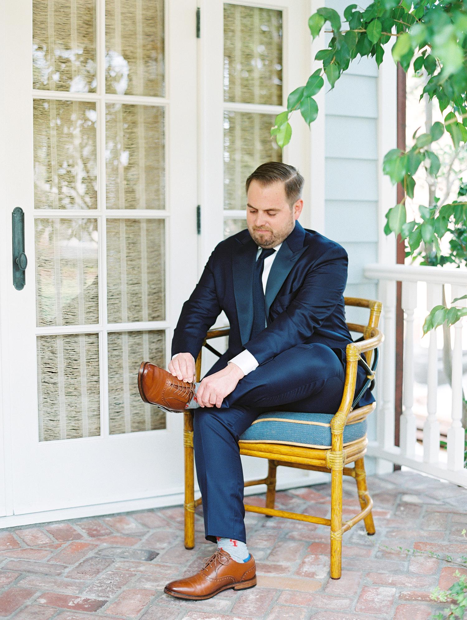 elizabeth scott wedding groom putting on shoes