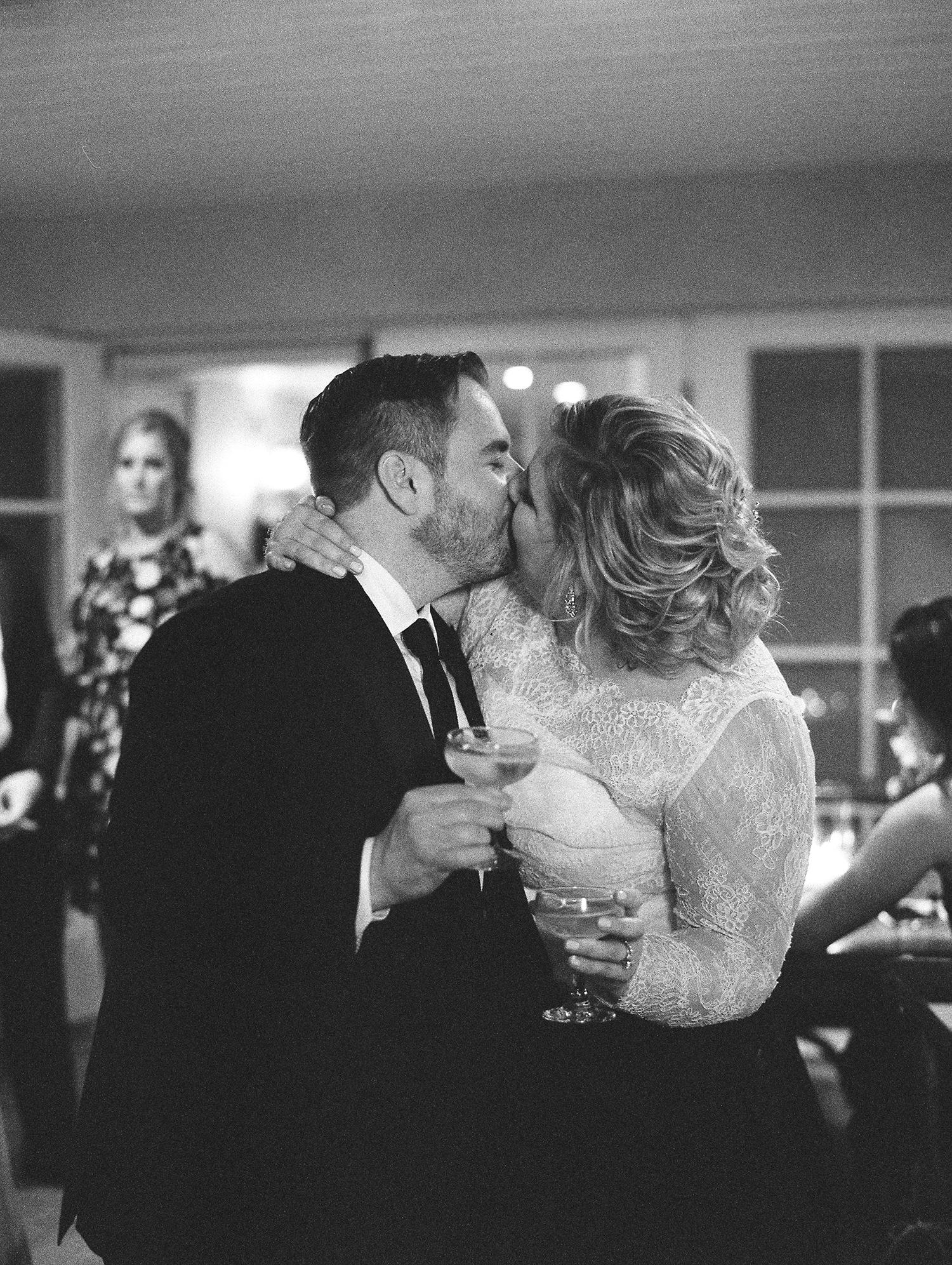 elizabeth scott wedding couple kissing toast