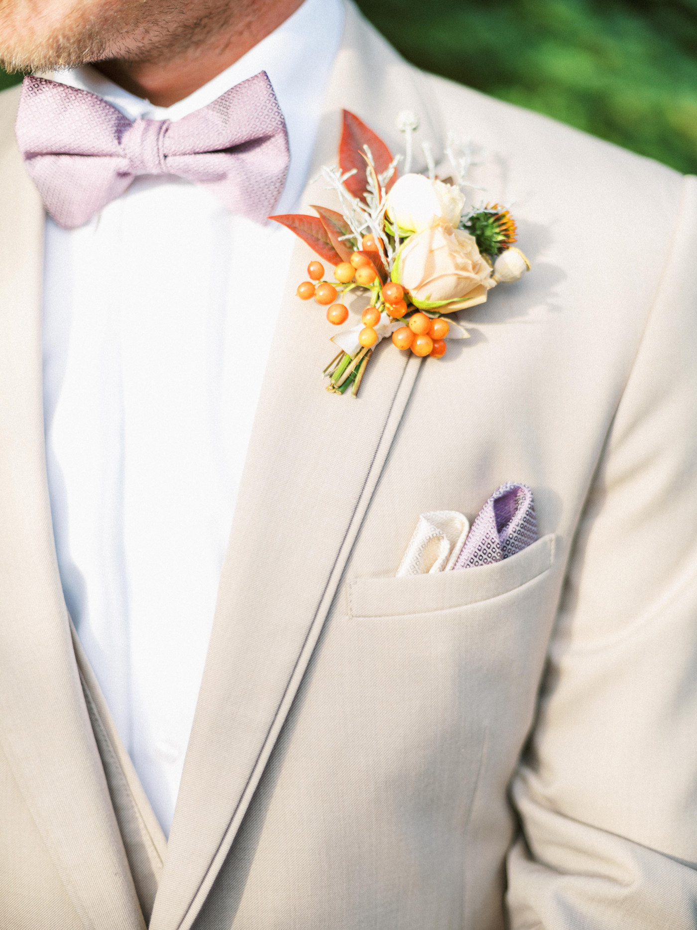 orange berries and ivory flowers boutonnieres
