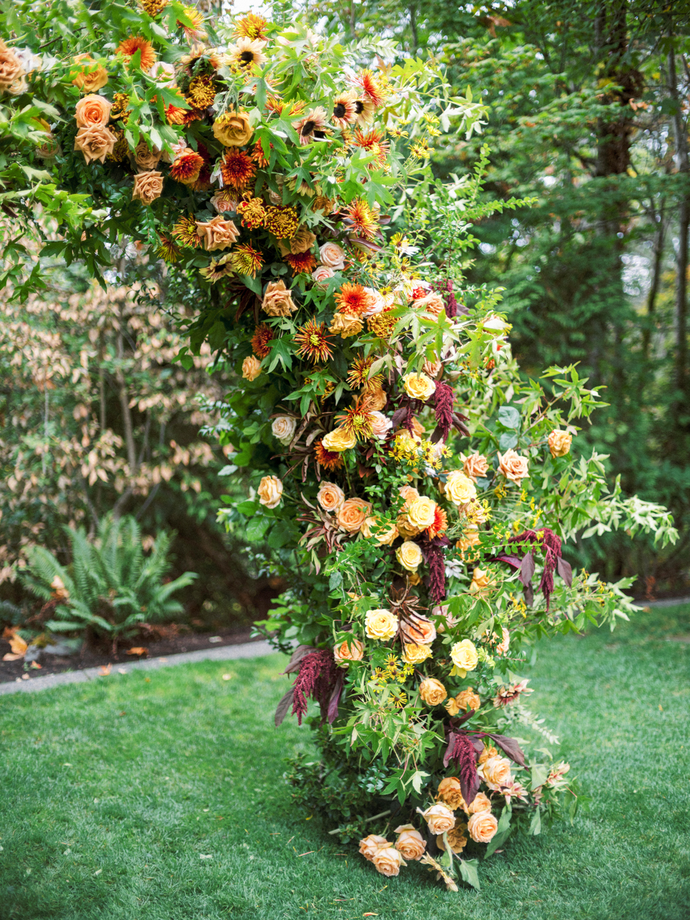 red peach and orange colored floral decorated arch