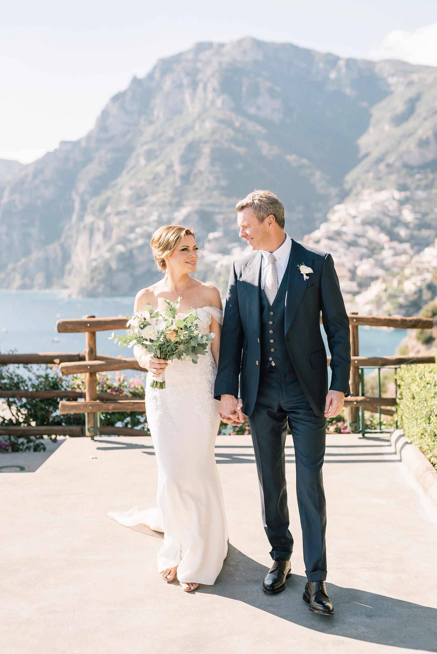 cara david wedding couple holding hands walking