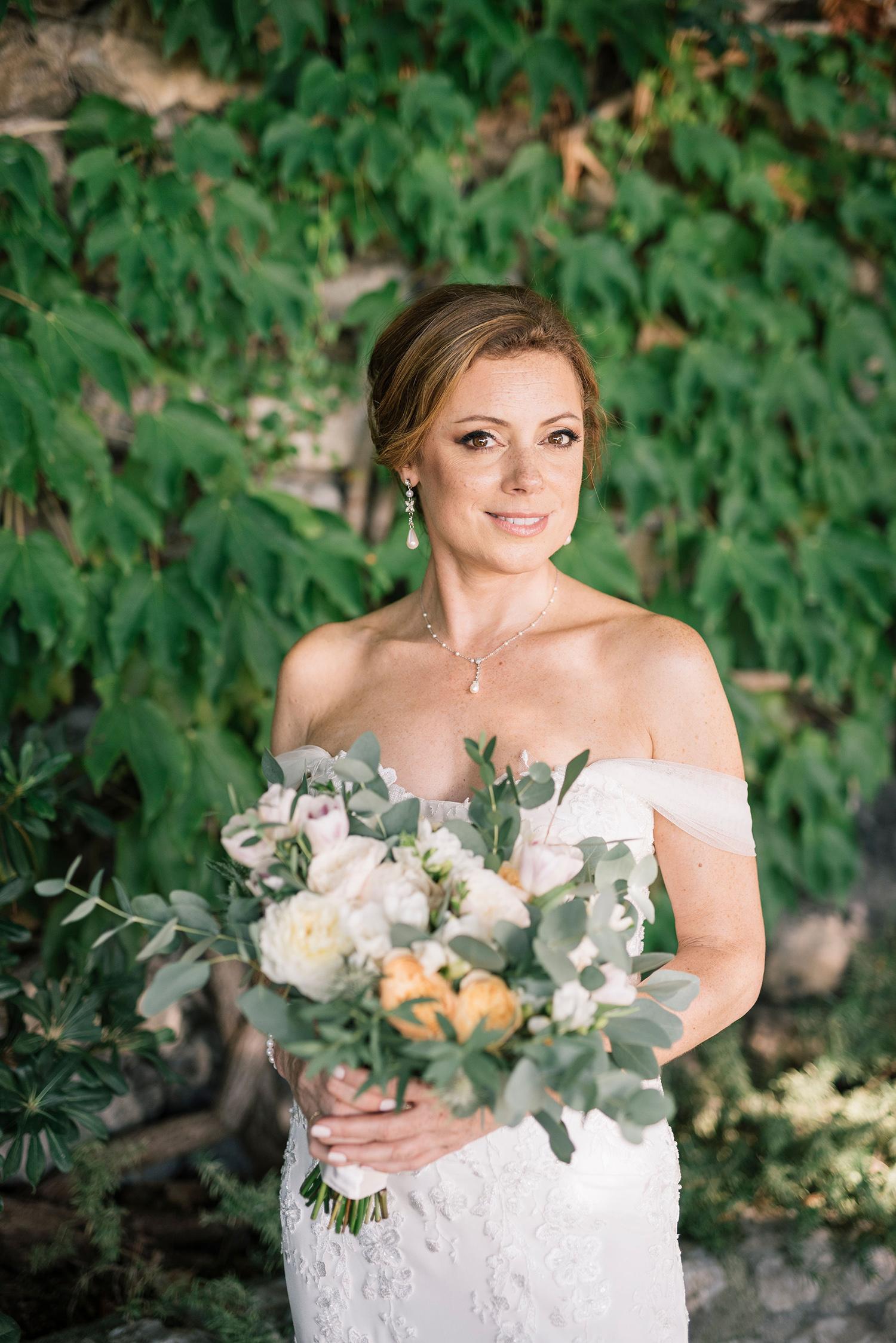cara david wedding bride in front of greenery