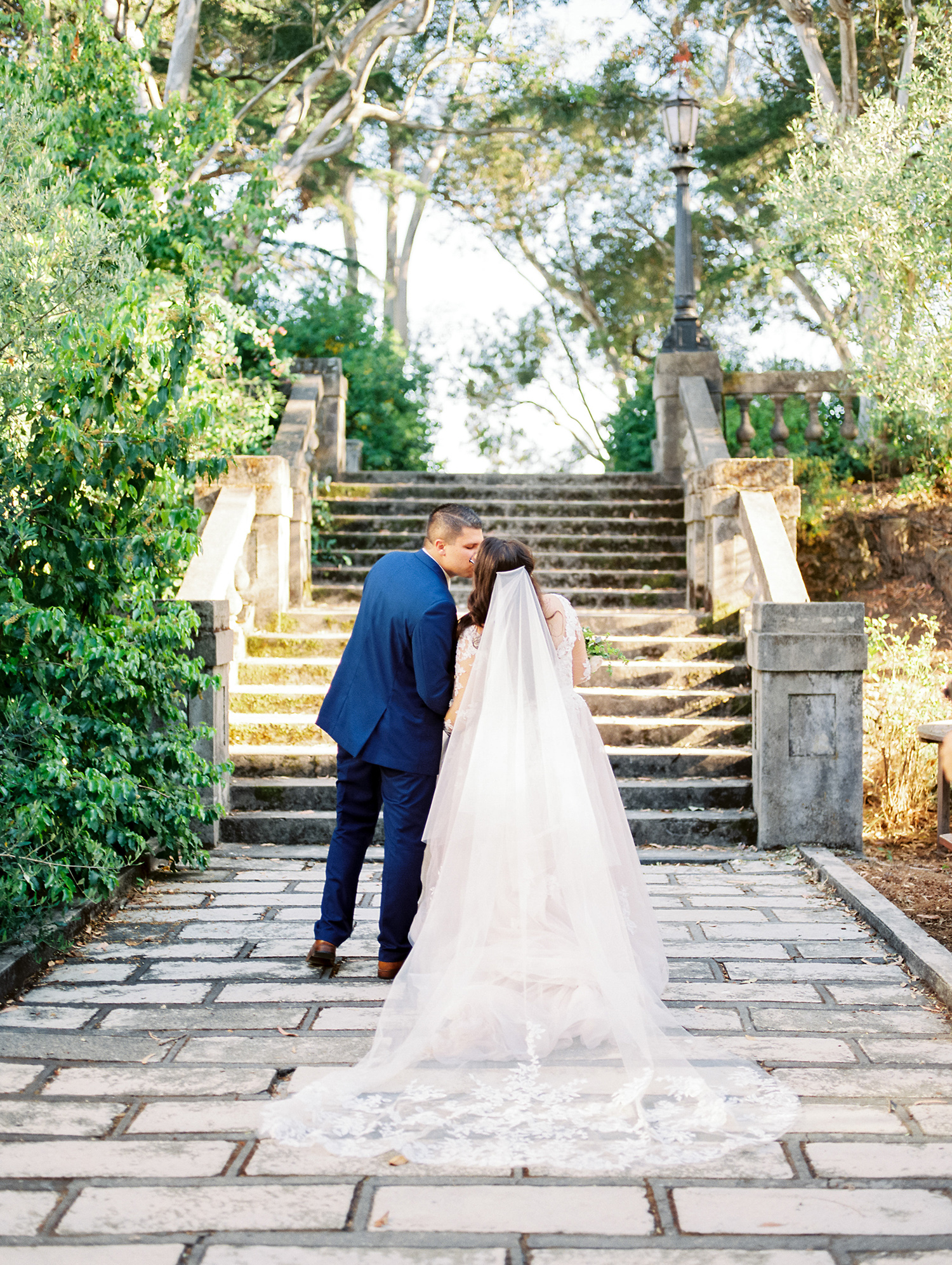 erika evan wedding couple in front of steps