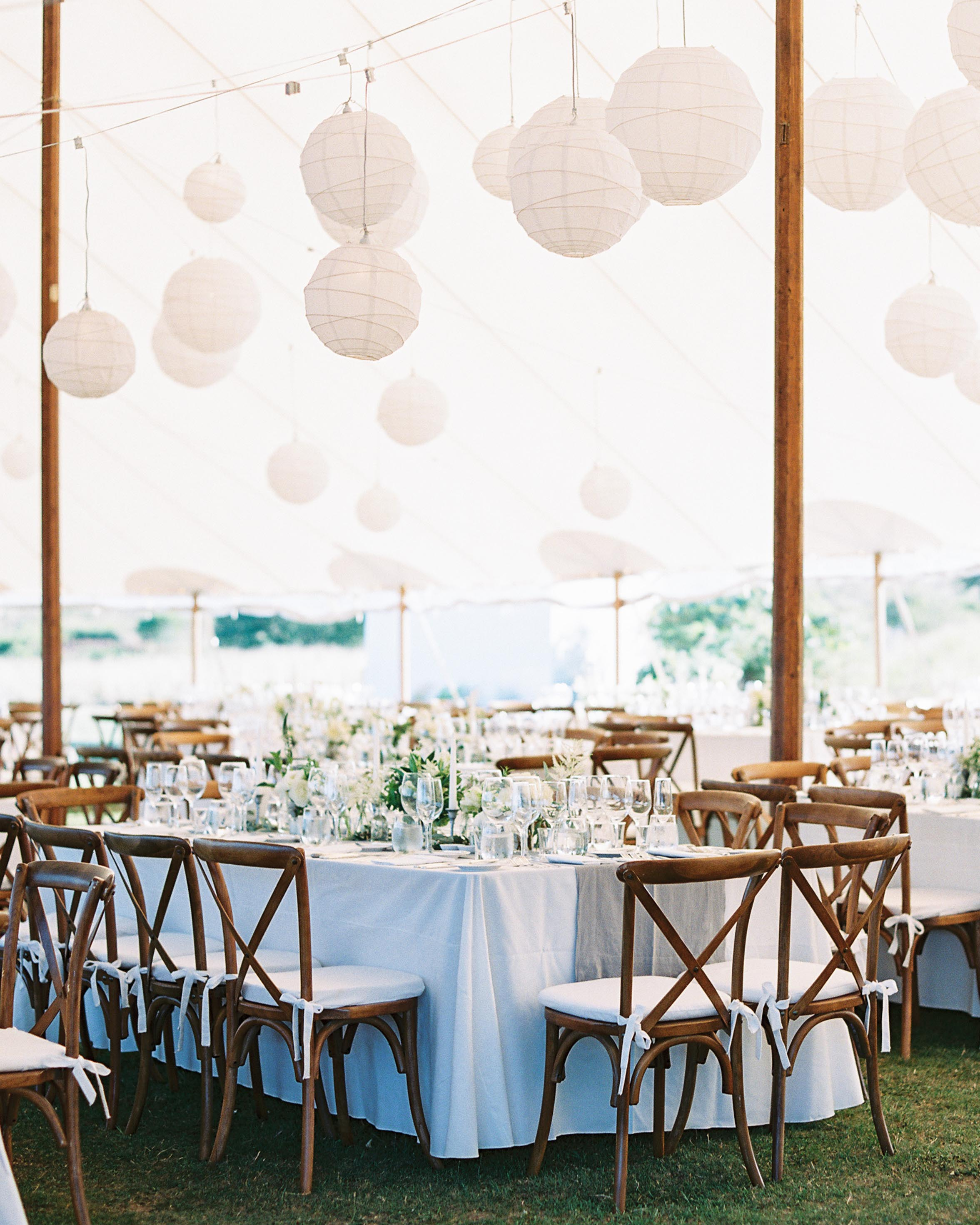 hanging paper lanterns over long reception tables