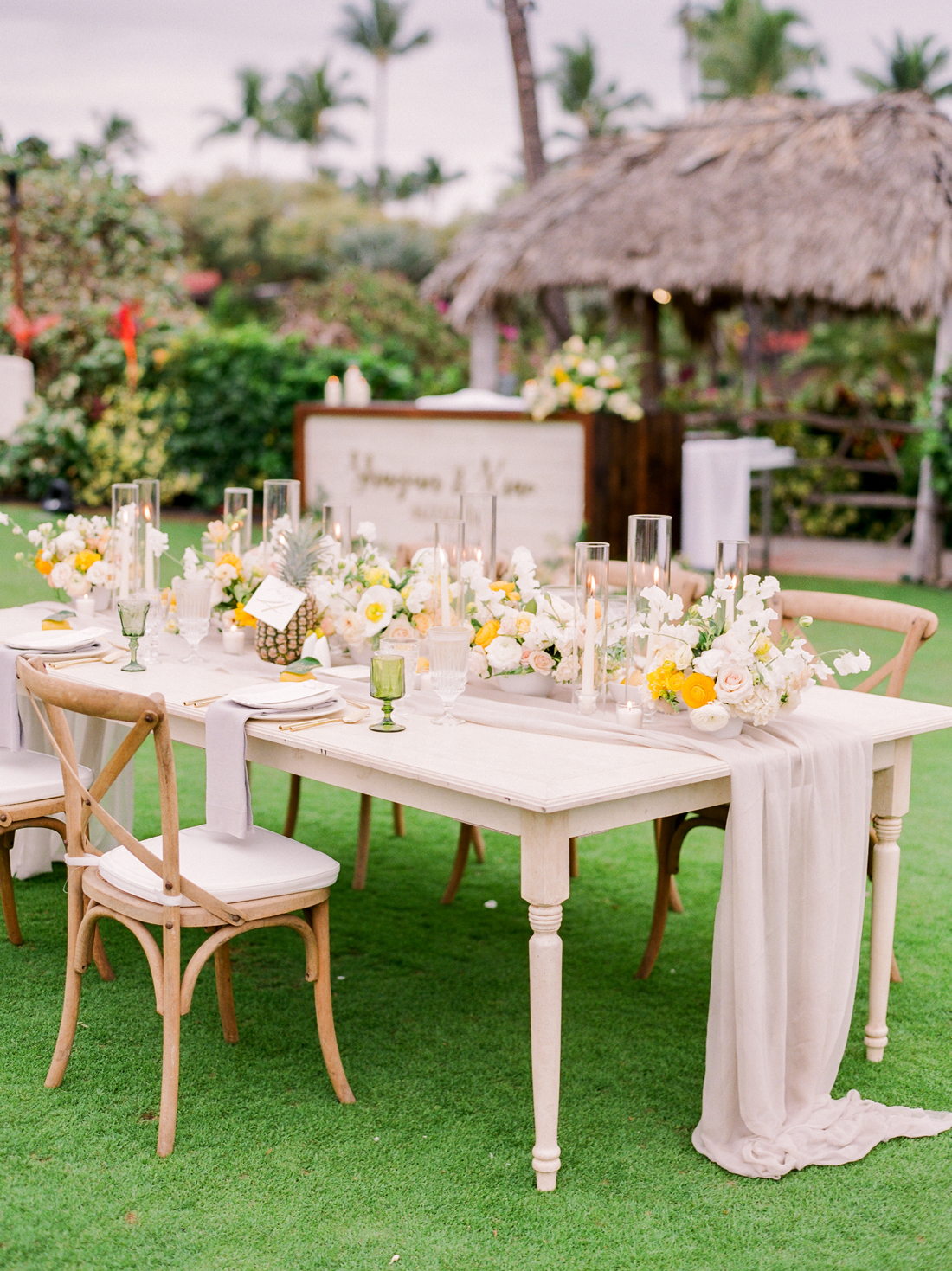 light gray and ivory table linens with yellow decor reception display