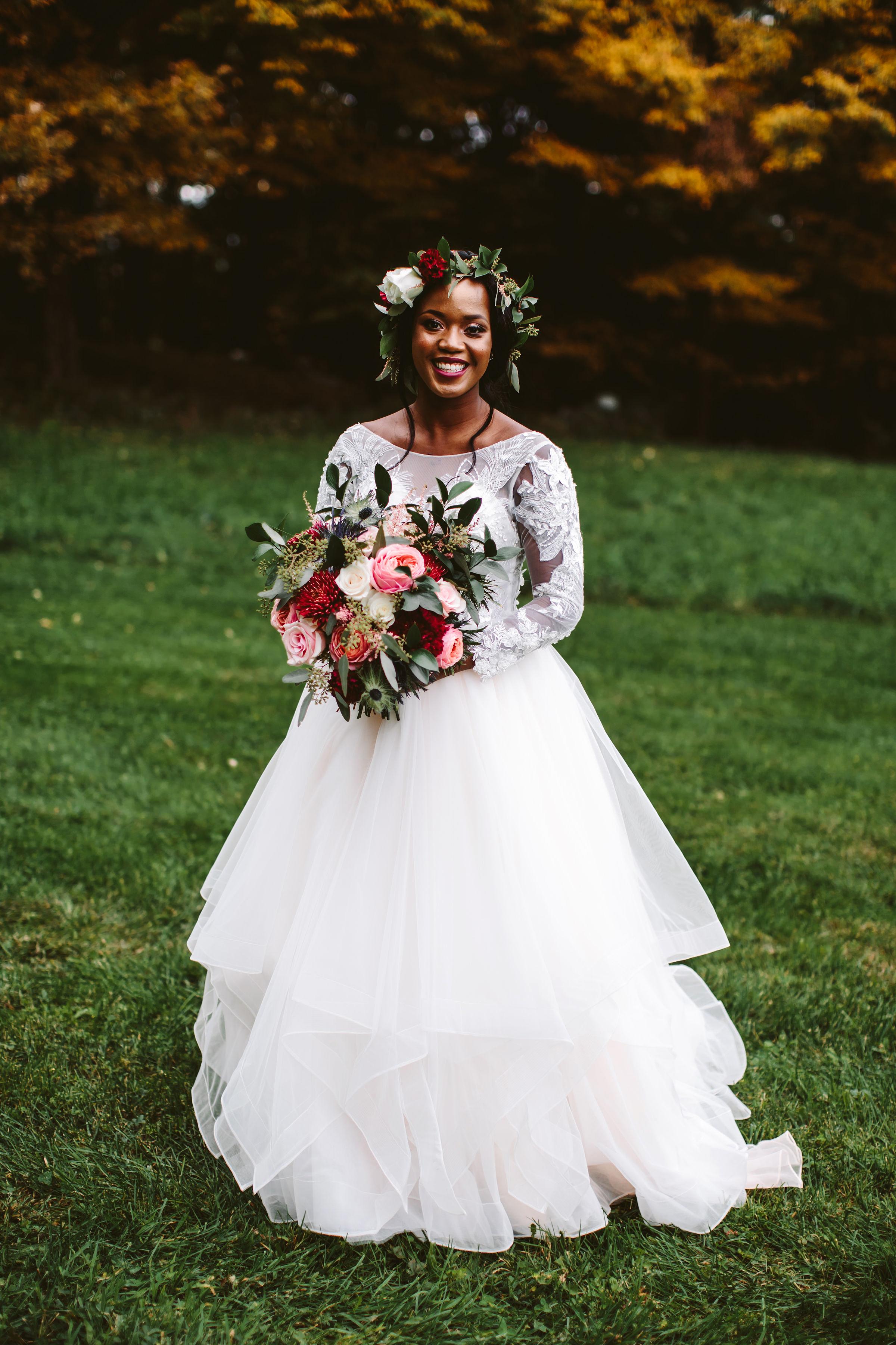 rivka aaron wedding bride dress bouquet flowers