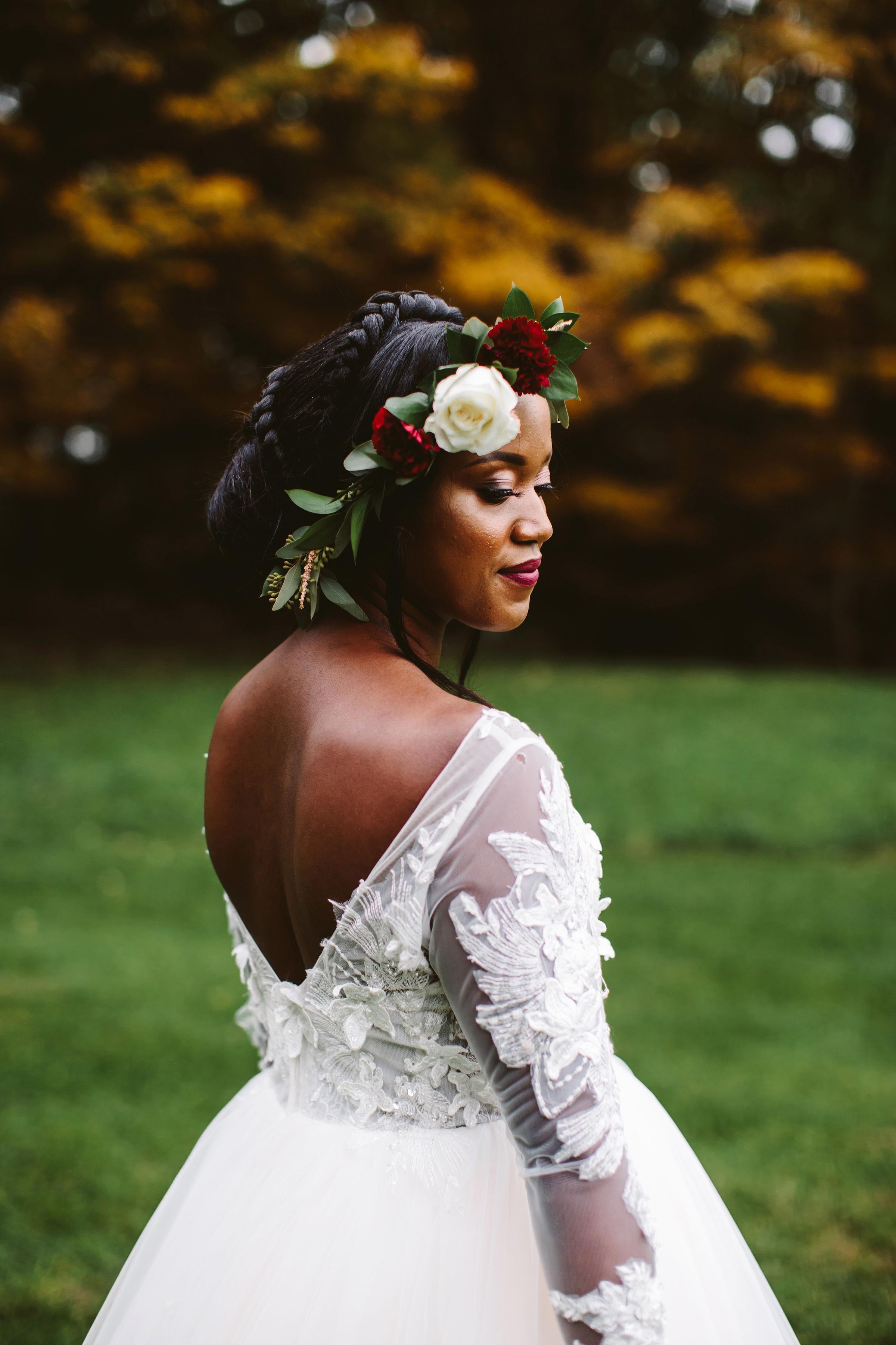 rivka aaron wedding bride low back dress flowers in hair