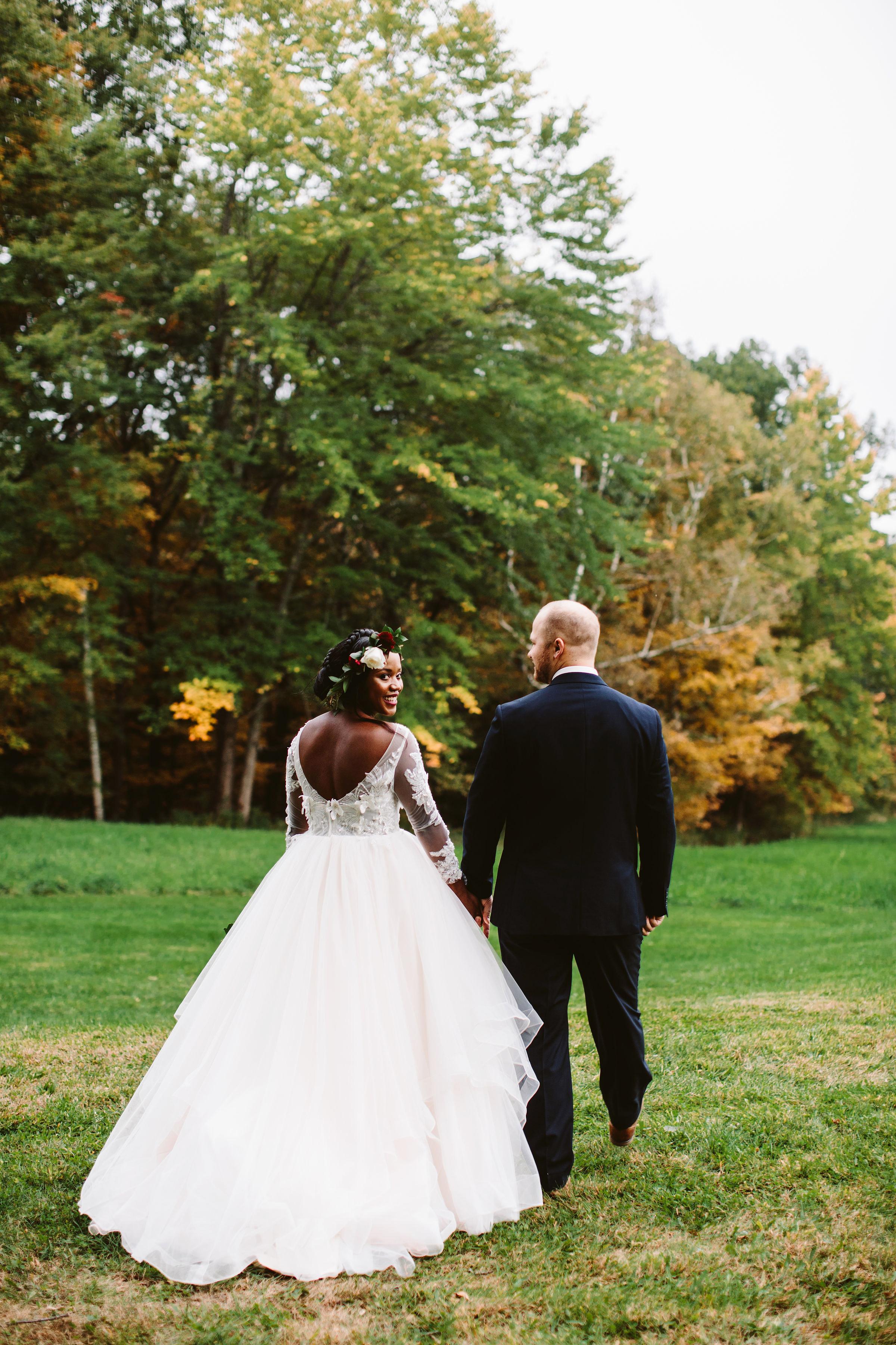 rivka aaron wedding couple bride groom walking away outdoors