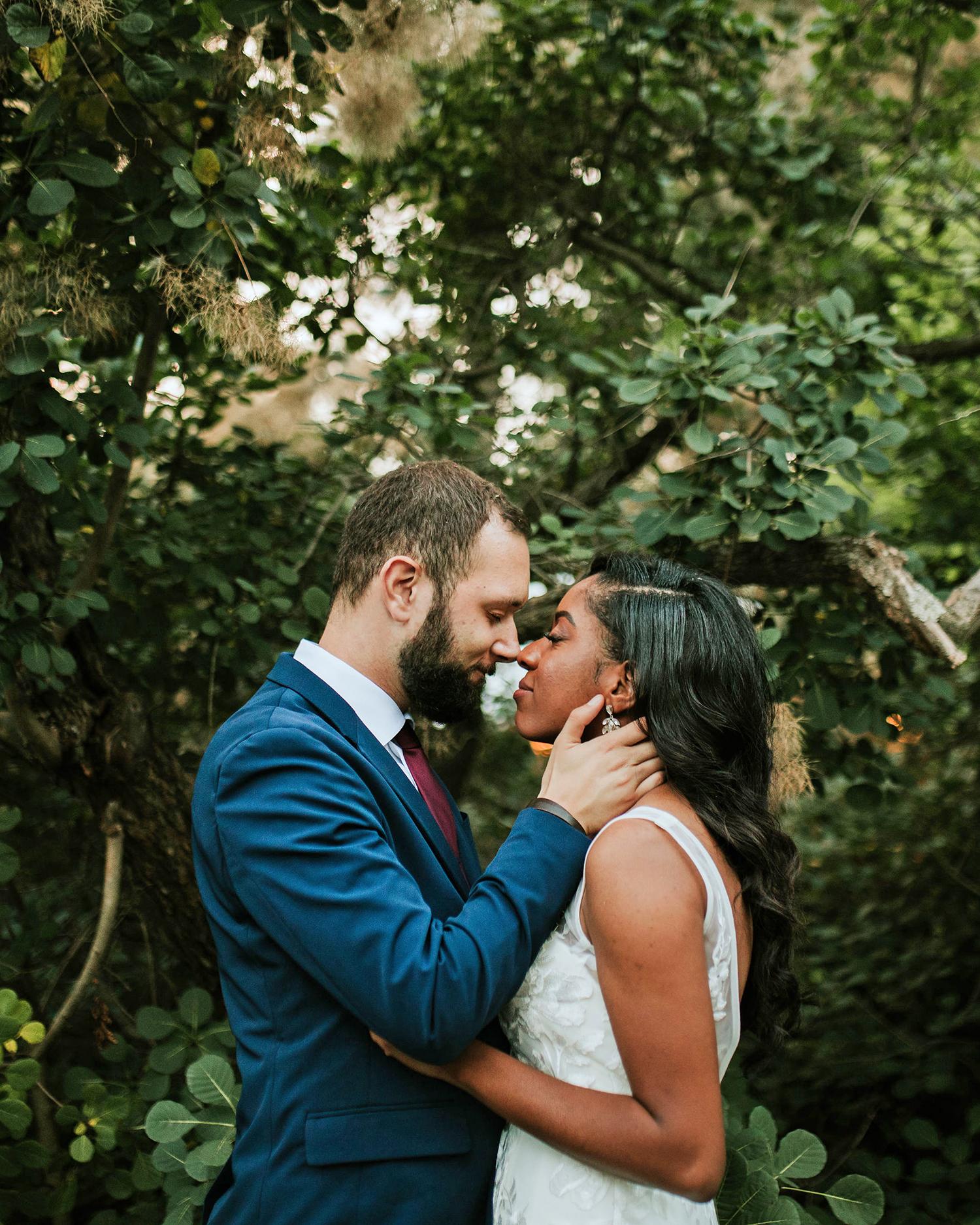 ferbie rob boho wedding couple in forest kiss