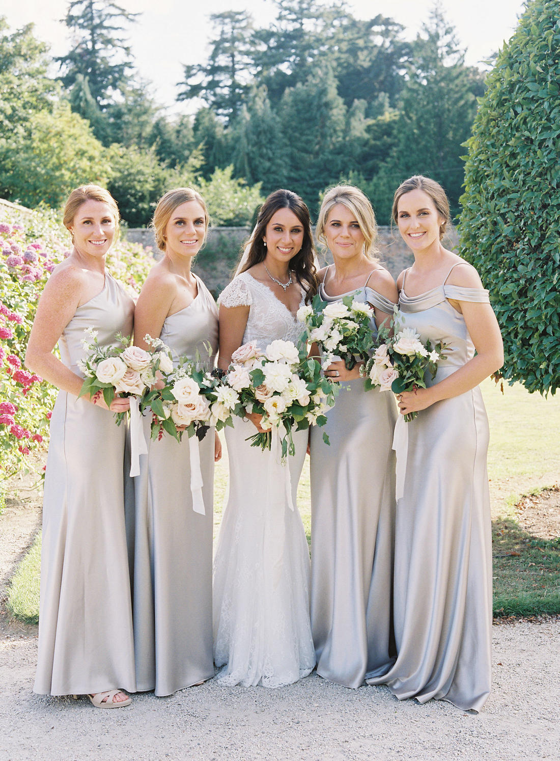 bridesmaids wearing champagne-colored Jenny Yoo floor-length dresses