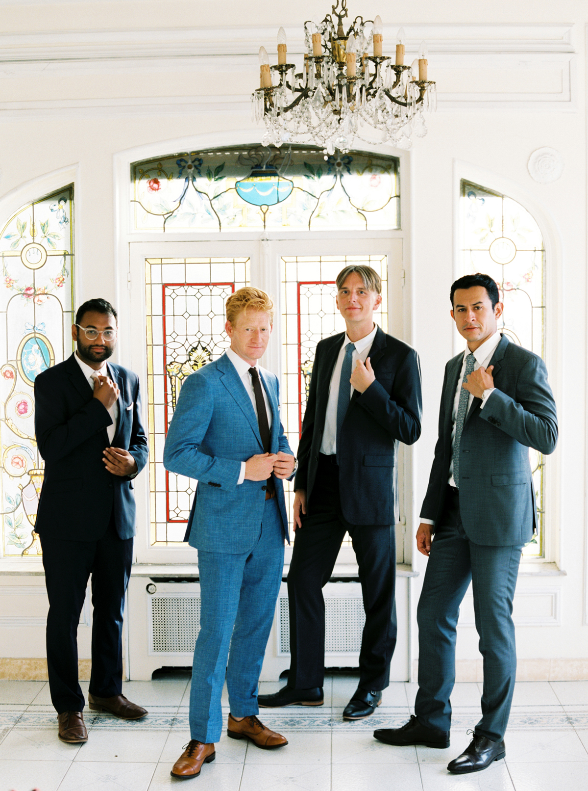 groom with groomsmen in neutral toned suit