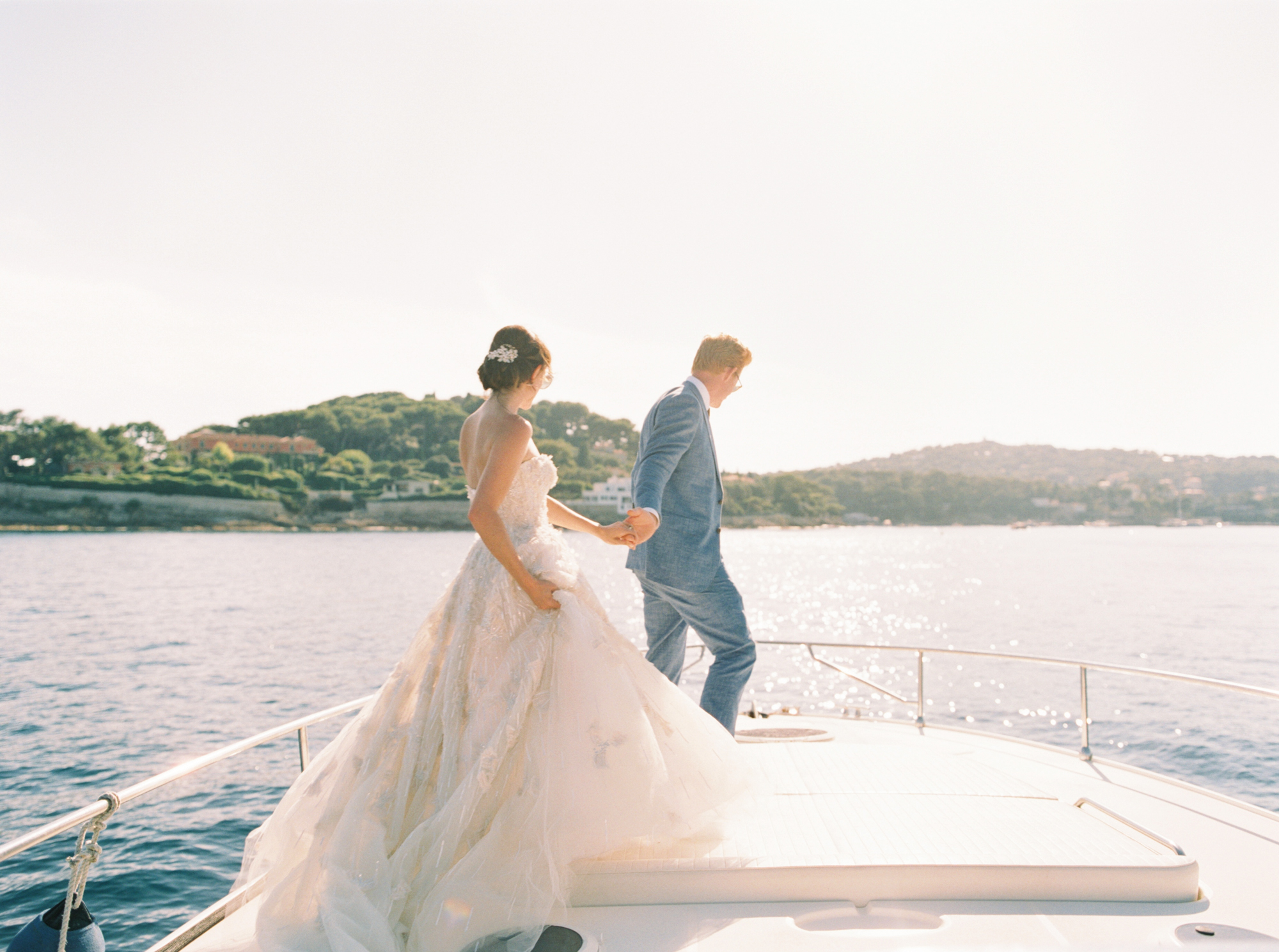 bride and groom standing on boat