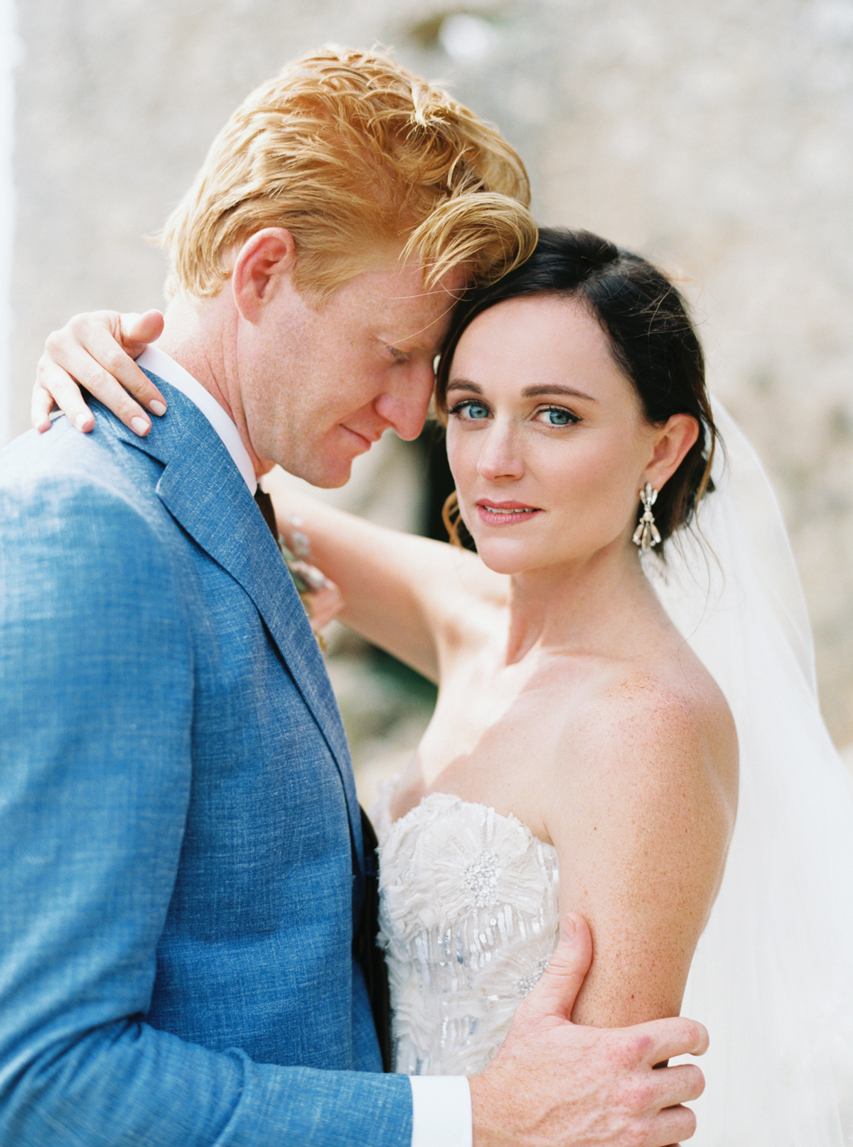 bride and groom pose for portrait south of france venue