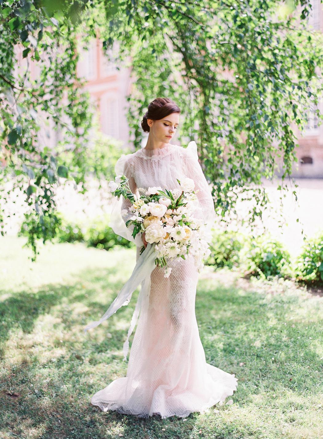 bride wearing high neck wedding dress
