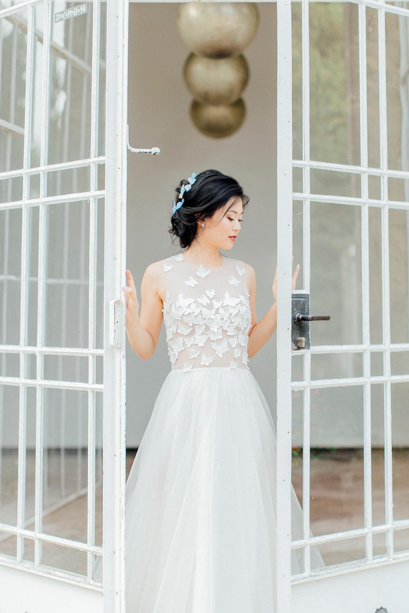 bride wearing wedding dress with Butterfly Appliqués