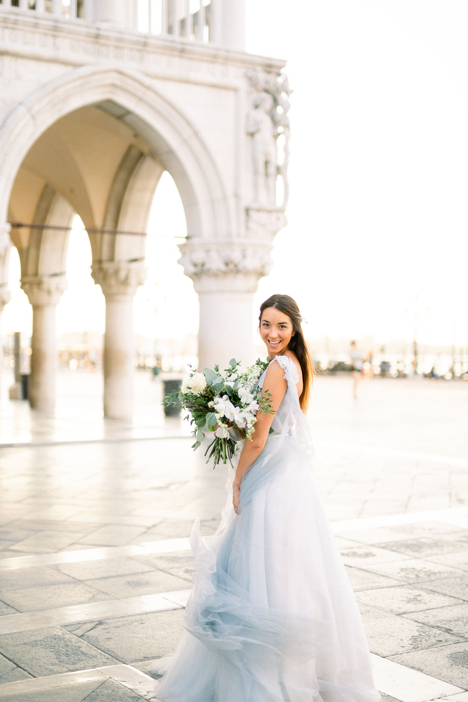 bride wearing light blue wedding dress