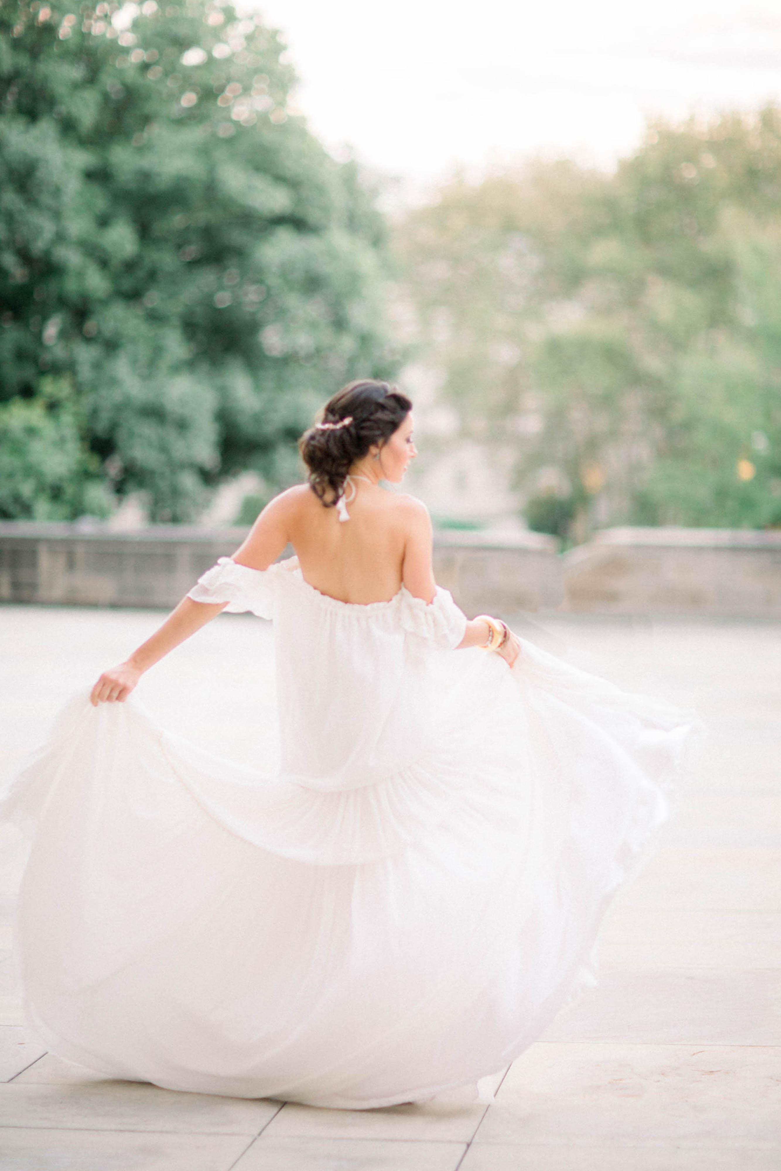 bride wearing off-the-shoulder flowy dress
