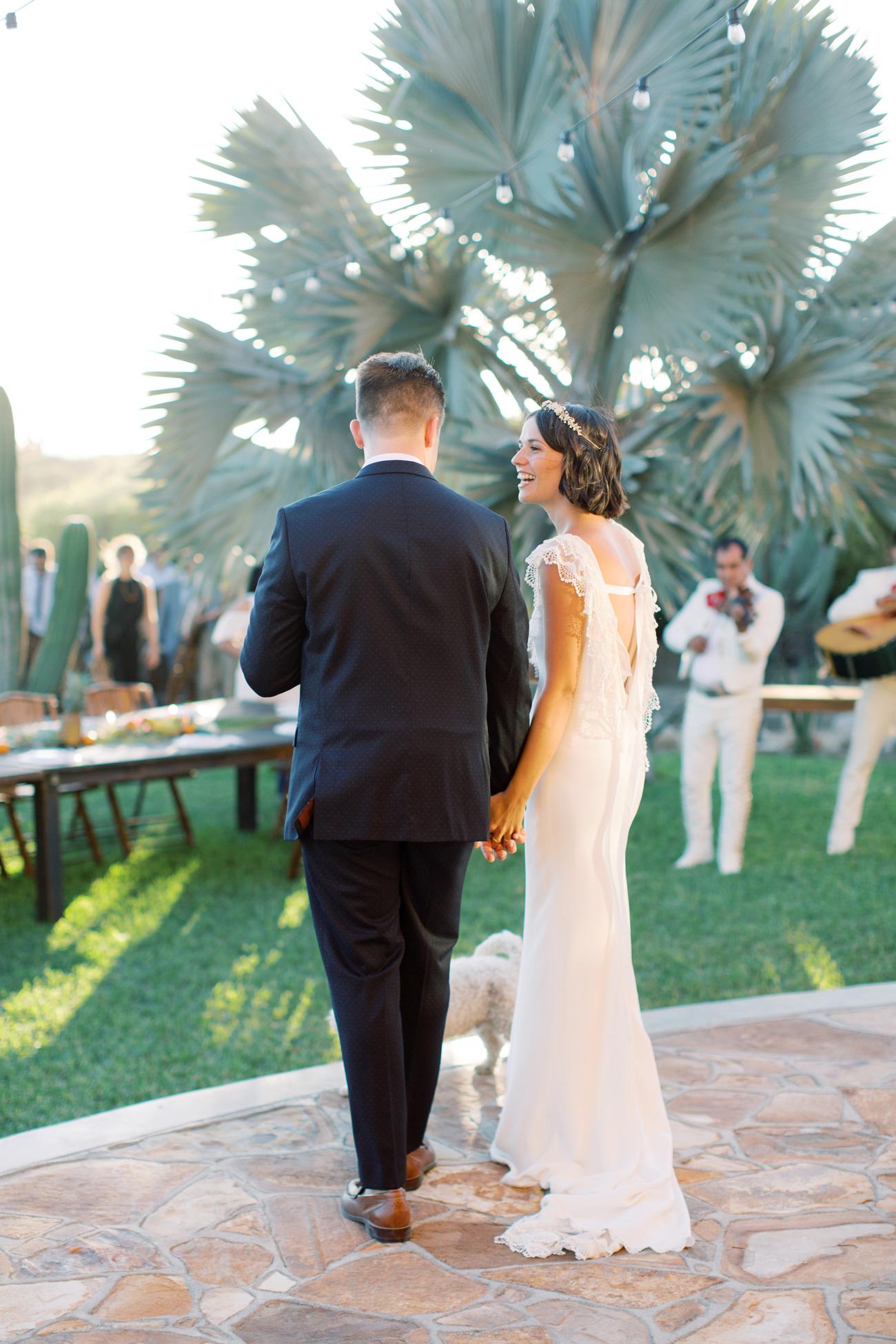 bride wearing ruffled back wedding dress