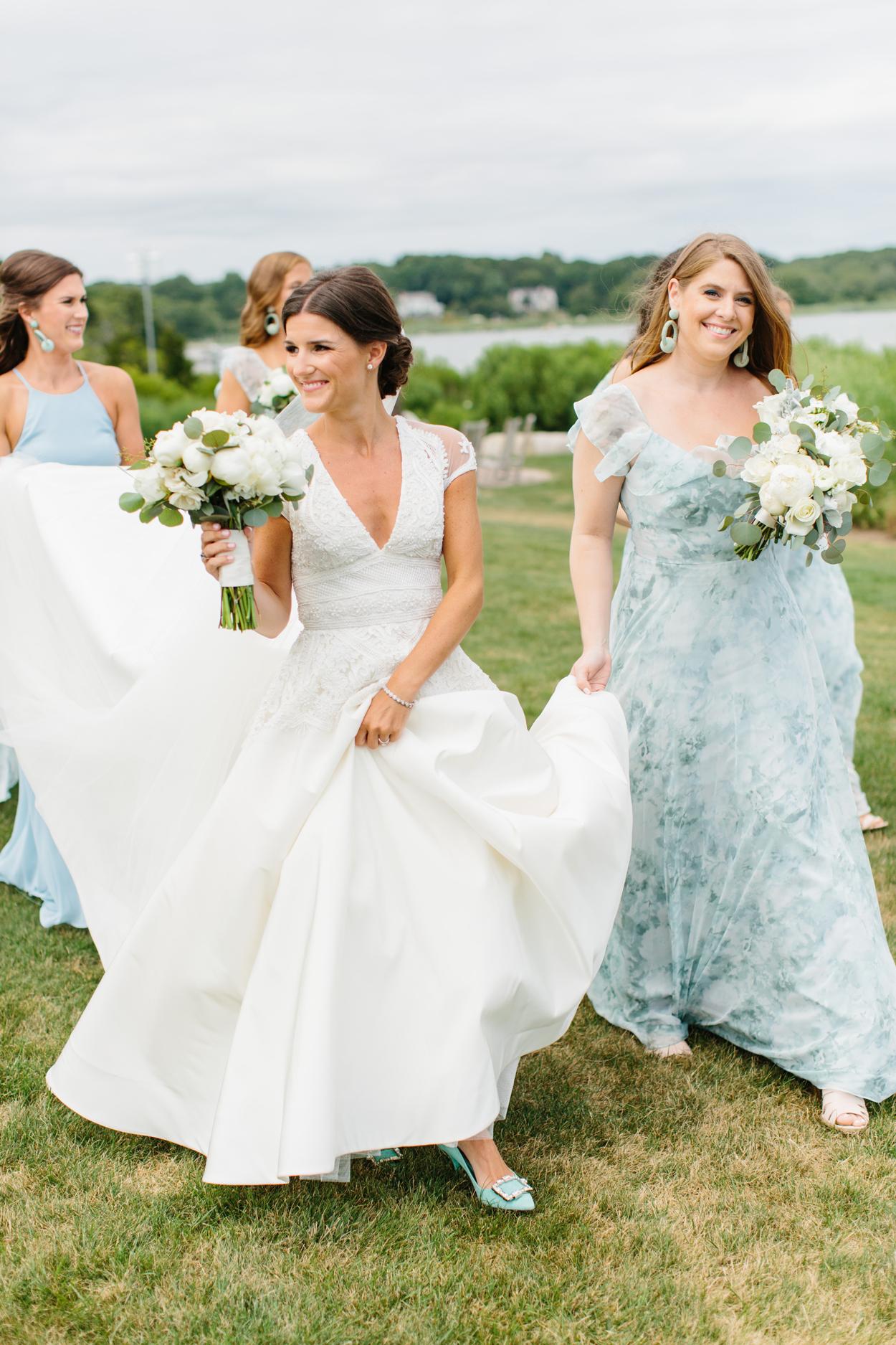 bride wearing v-neck cap sleeve wedding dress