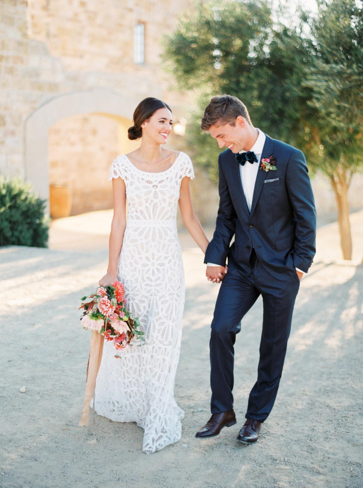 bride wearing lace cap sleeve wedding dress