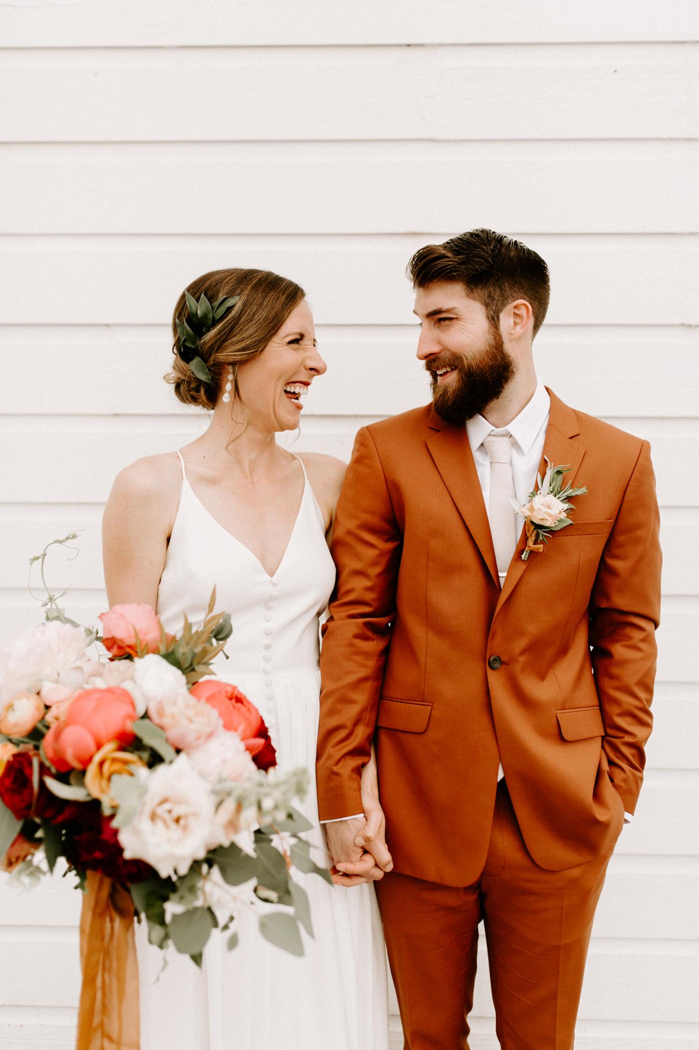 unique wedding color palettes burnt orange suit pink white flowers