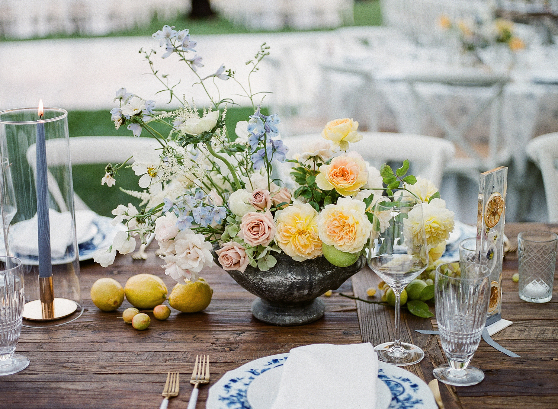 citrus colored floral centerpieces with citrus fruit table displays