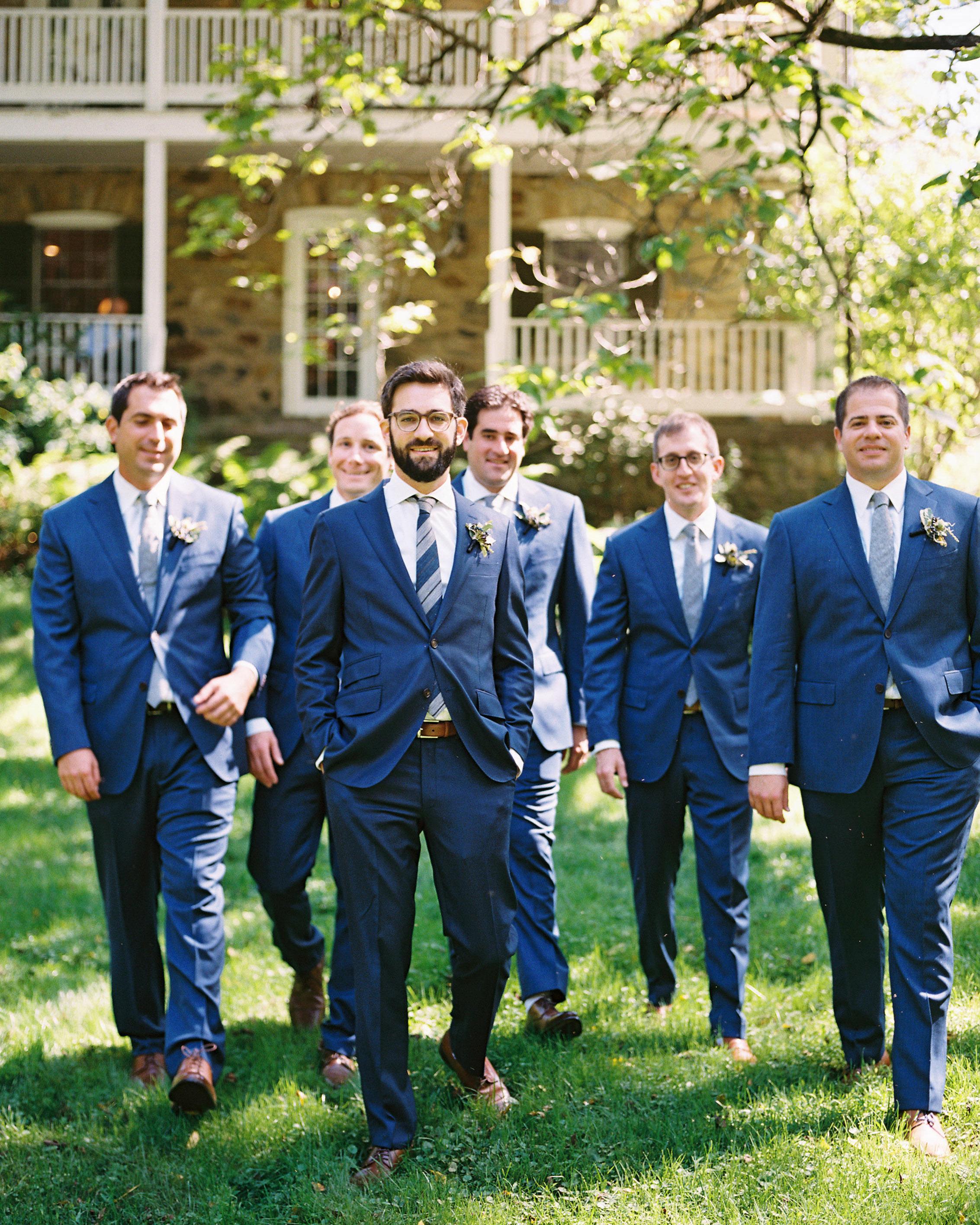 groom and groomsman in dark blue suits