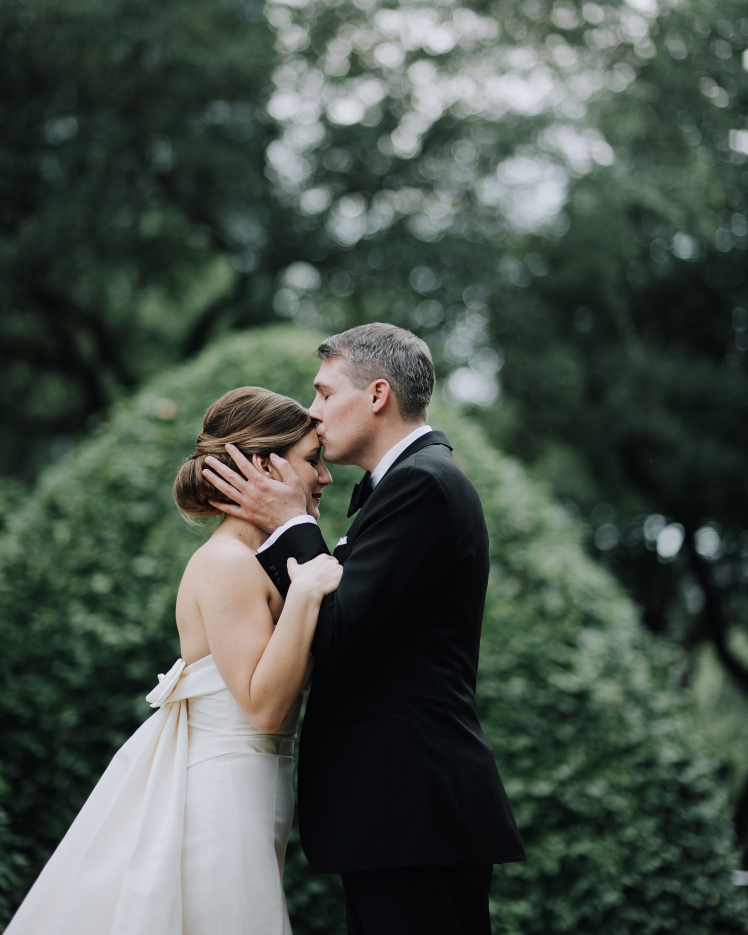 cathleen and winston wedding groom kissing brides forehead