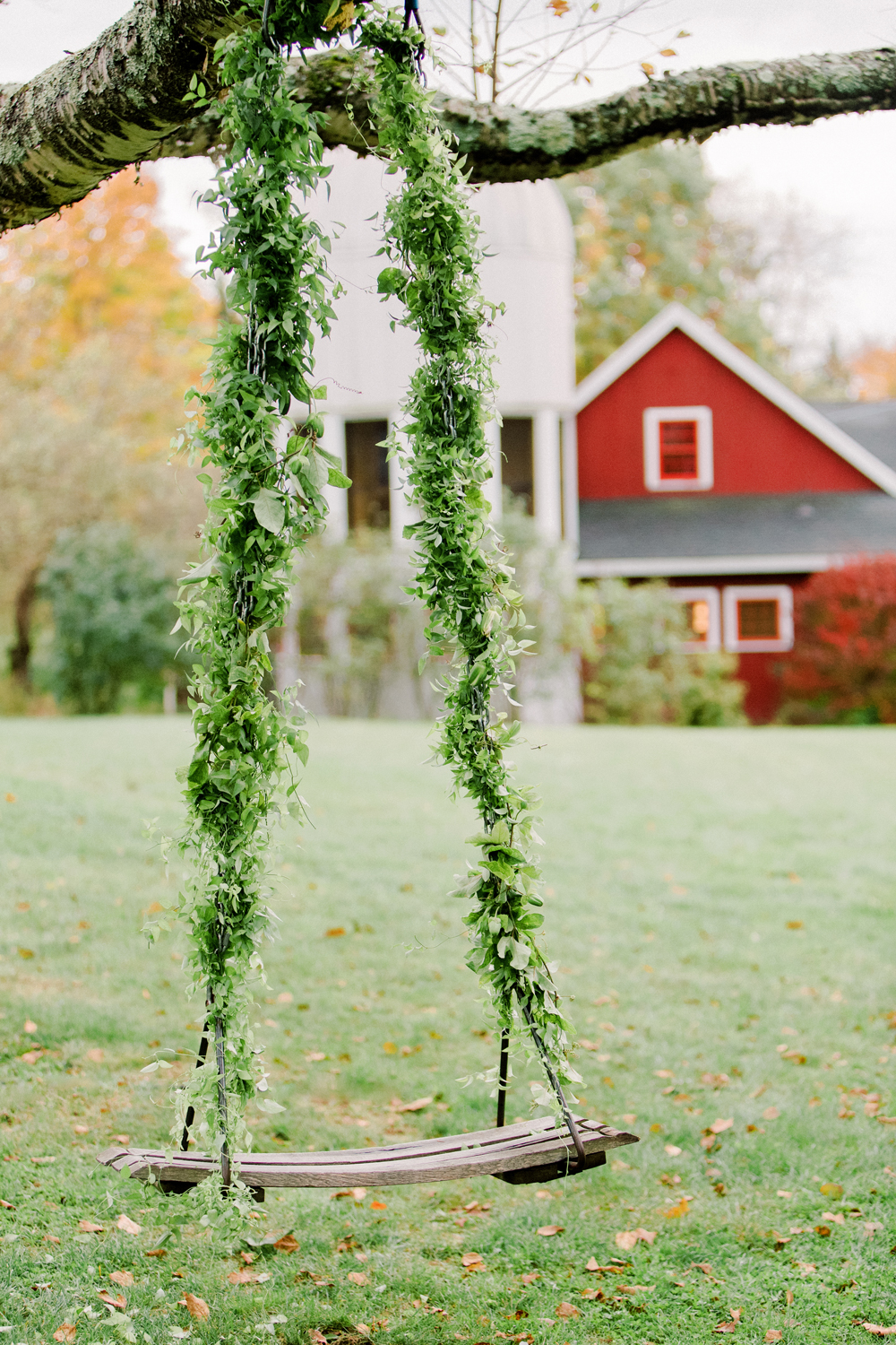 greenery covered hanging swing
