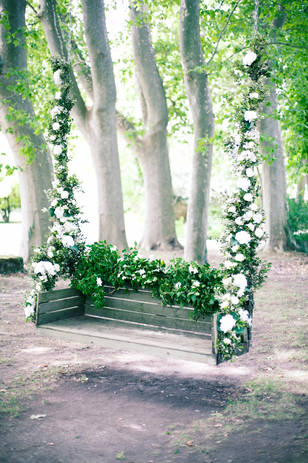 hanging porch rocker with white flowers