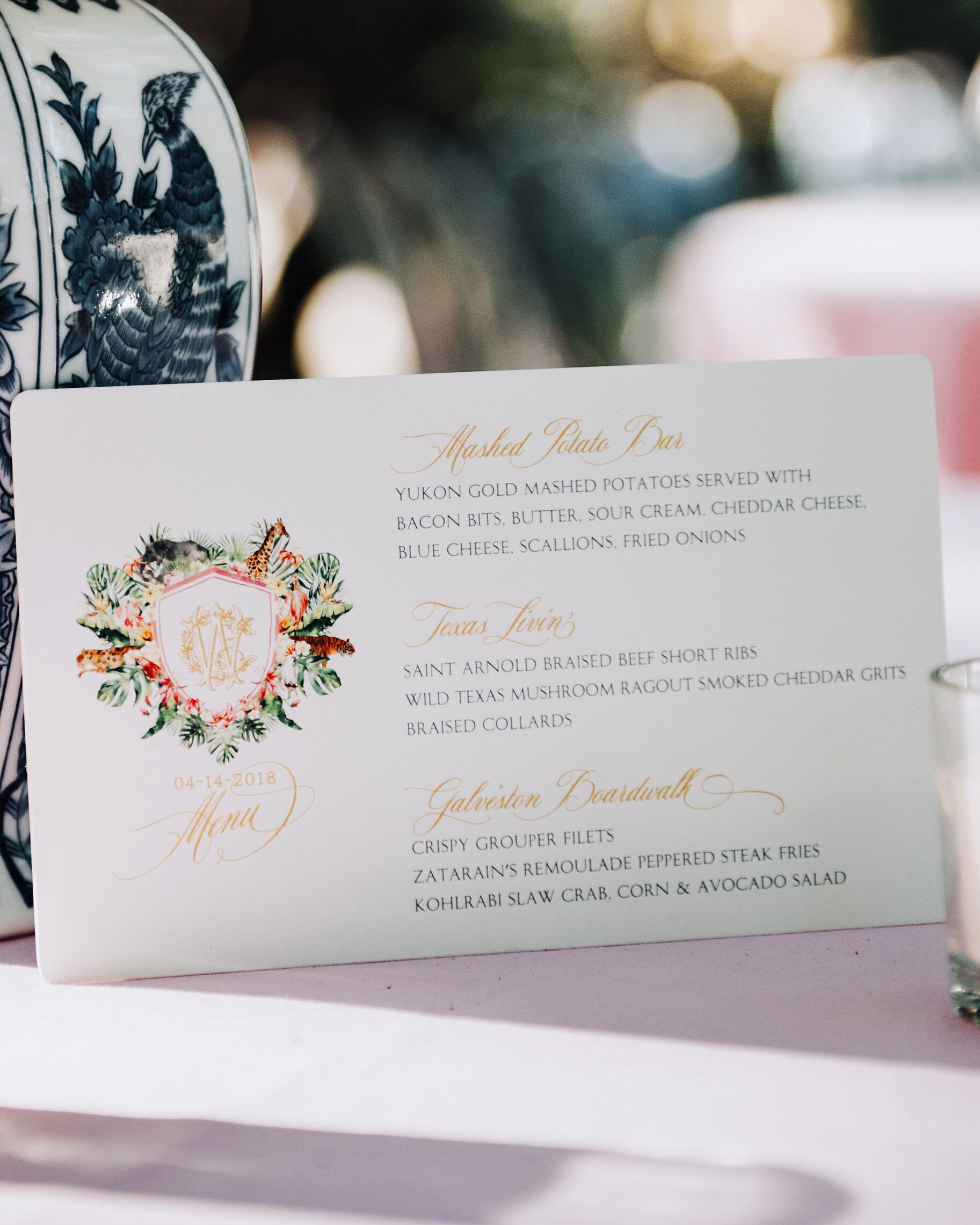 cathleen and winston wedding reception menu with monogrammed crest