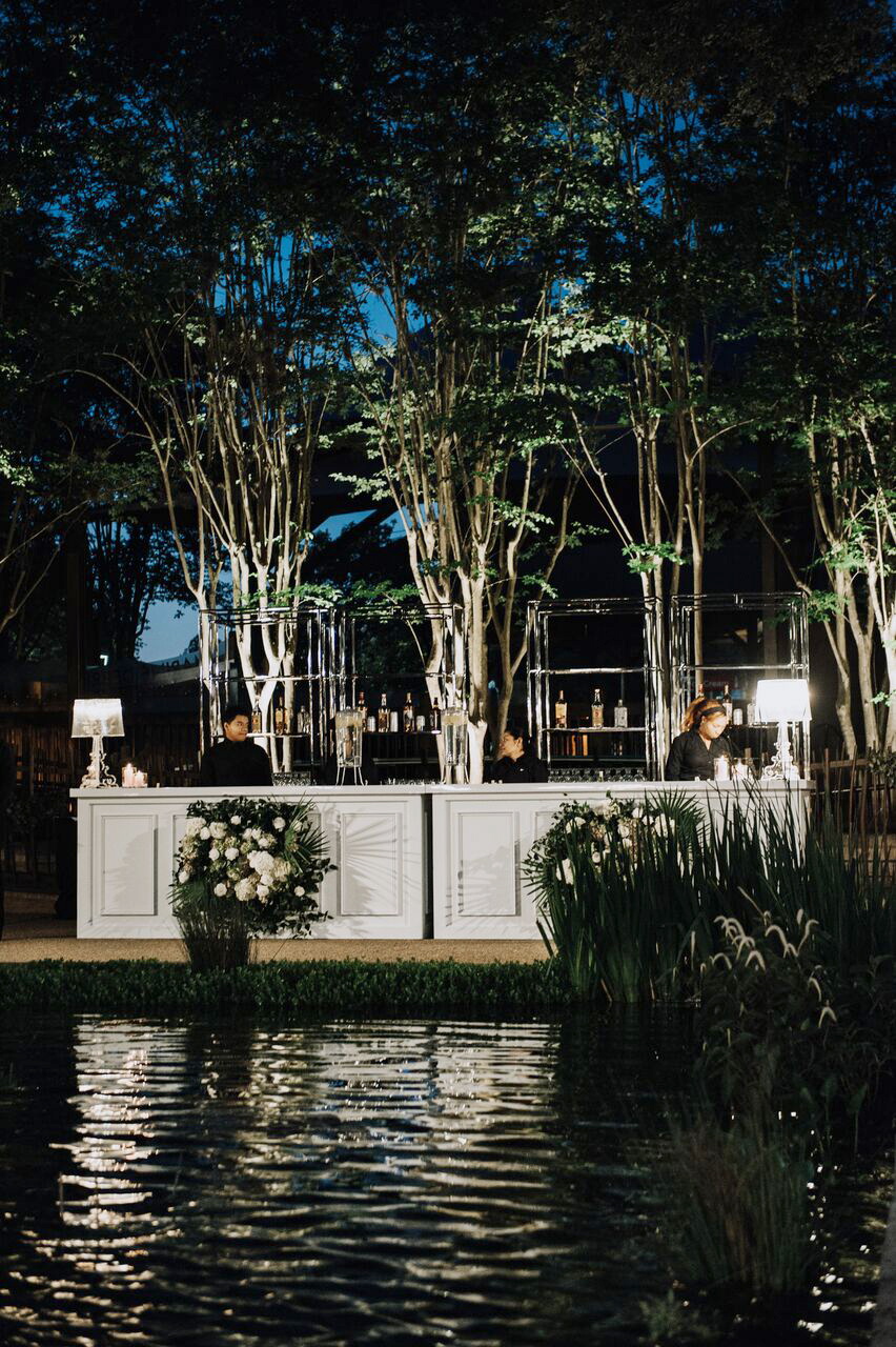 cathleen and winston wedding outdoor bar near water