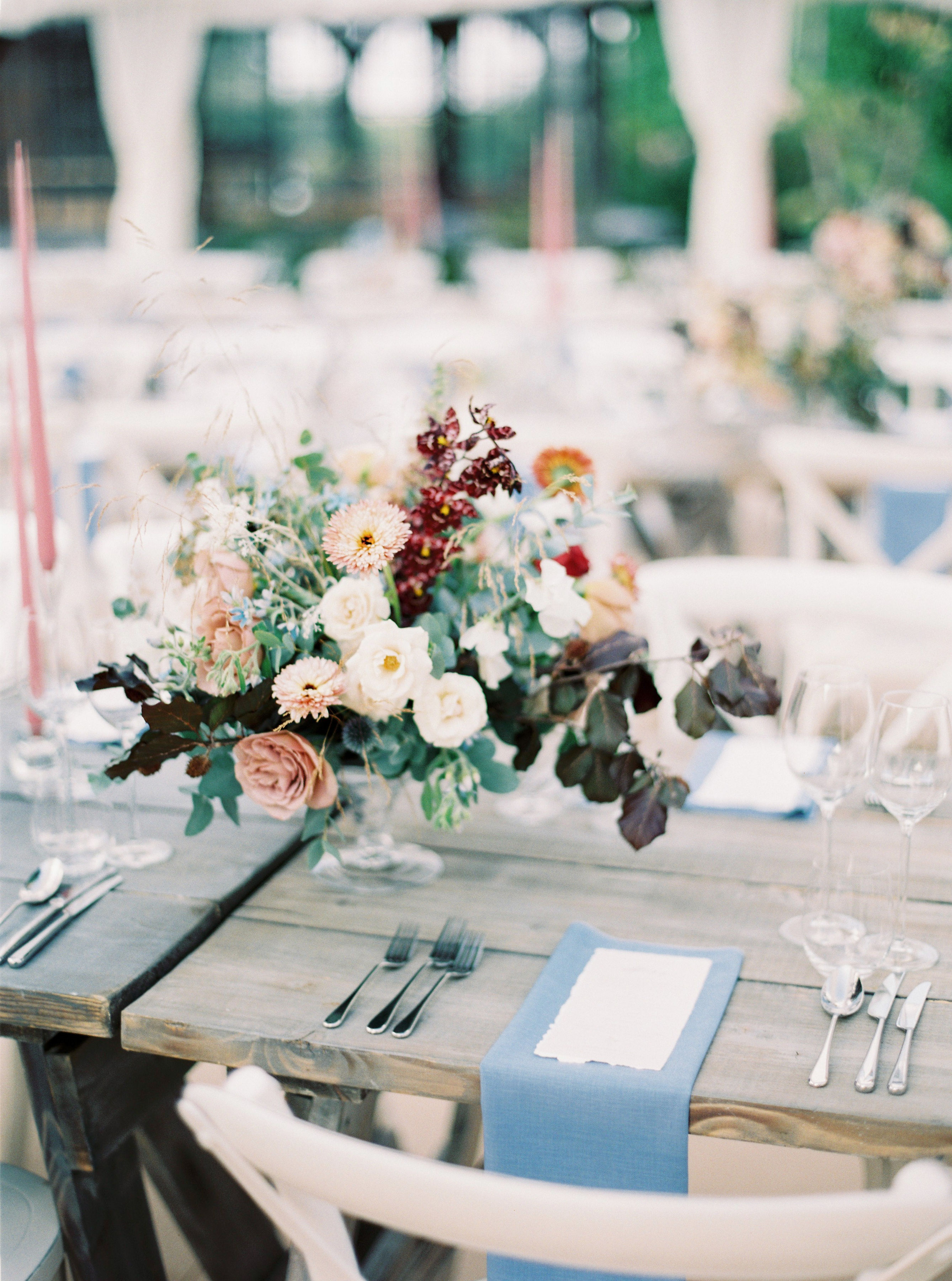 floral centerpieces, blue linens and personalized menus